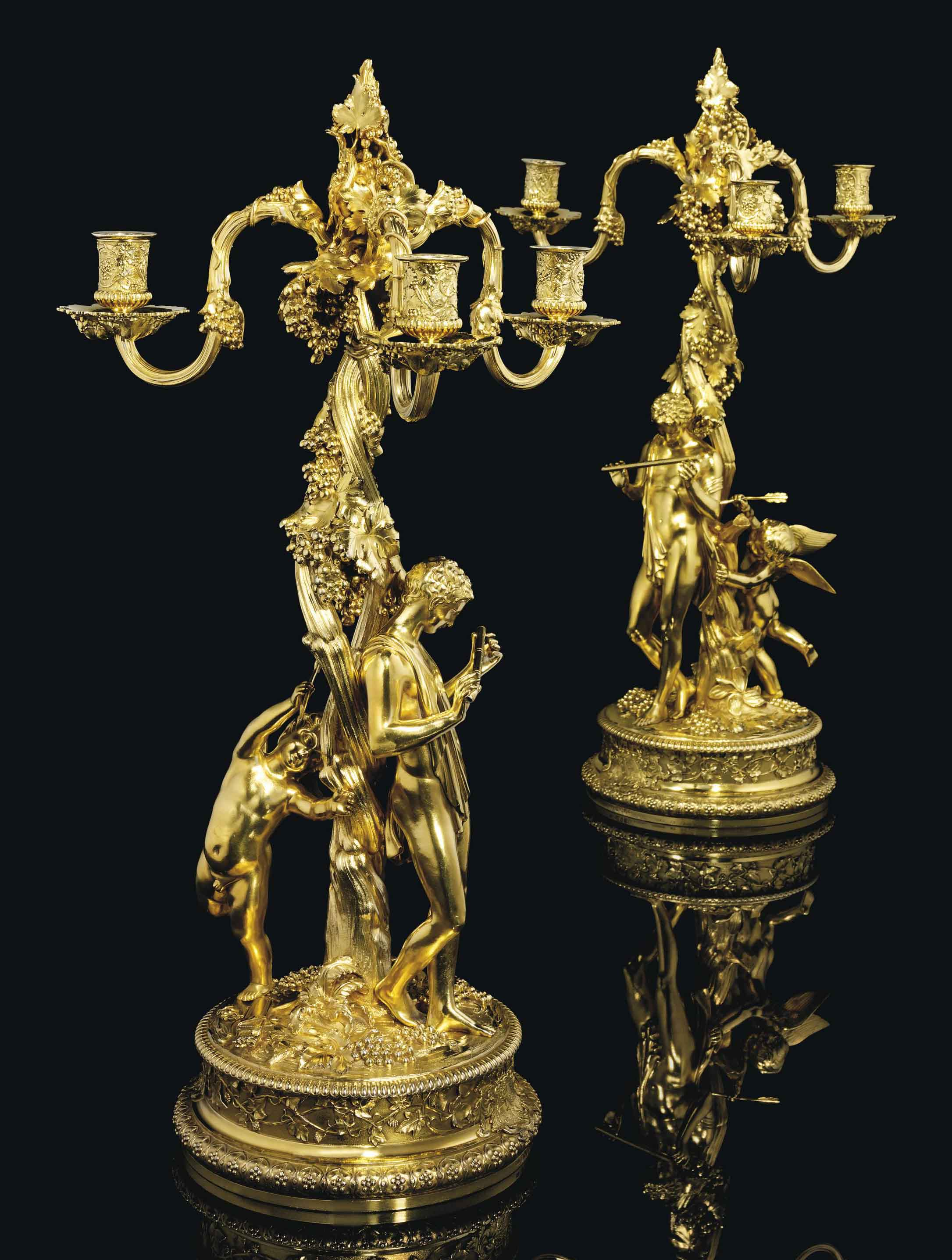 AN IMPORTANT PAIR OF GEORGE IV SILVER-GILT THREE-LIGHT CANDELABRA