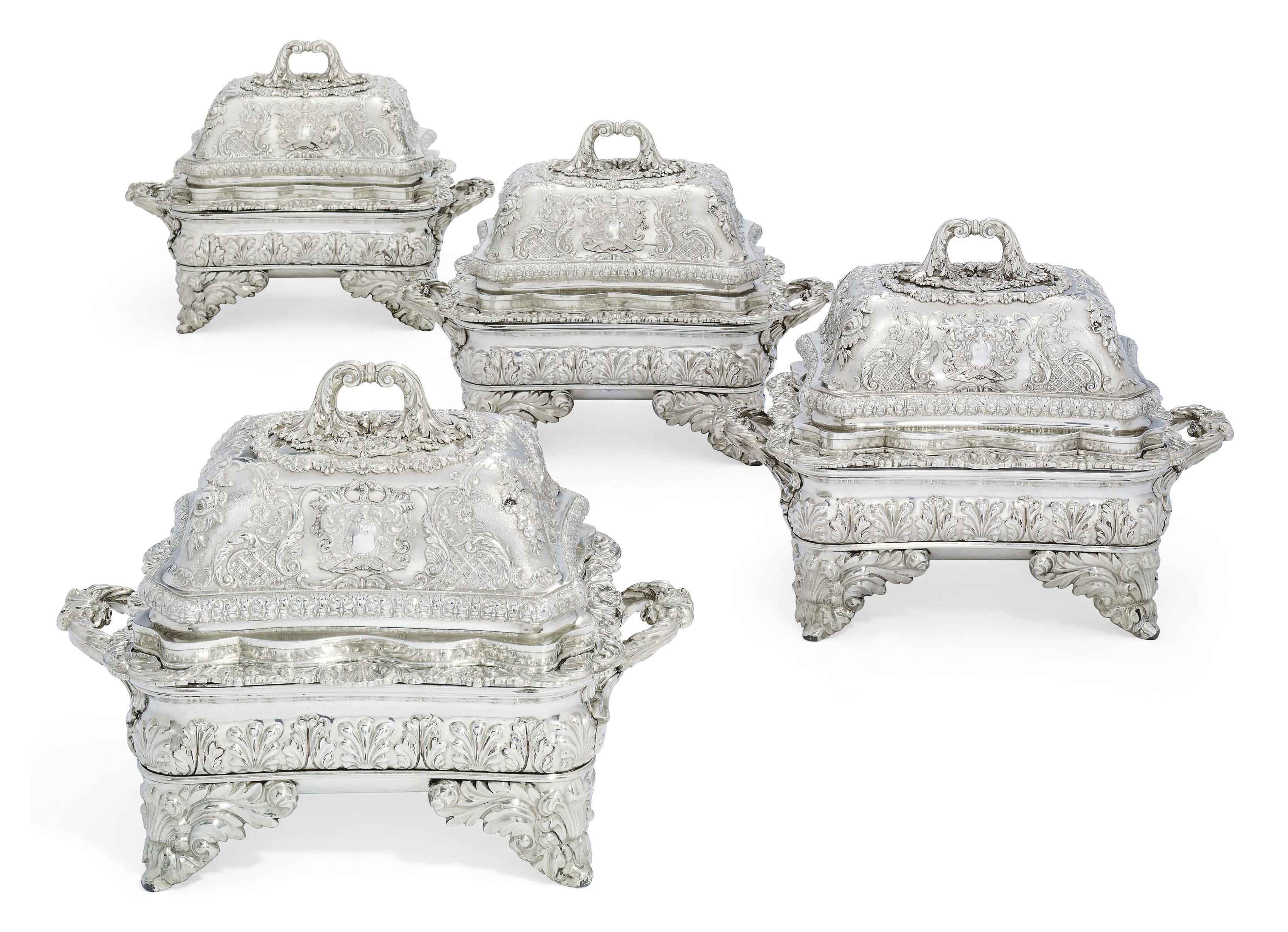 A SET OF FOUR GEORGE III SILVER ENTREE-DISHES, COVERS AND STANDS FROM THE SUTTON SERVICE