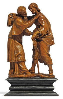 A CARVED BOXWOOD GROUP OF SS R