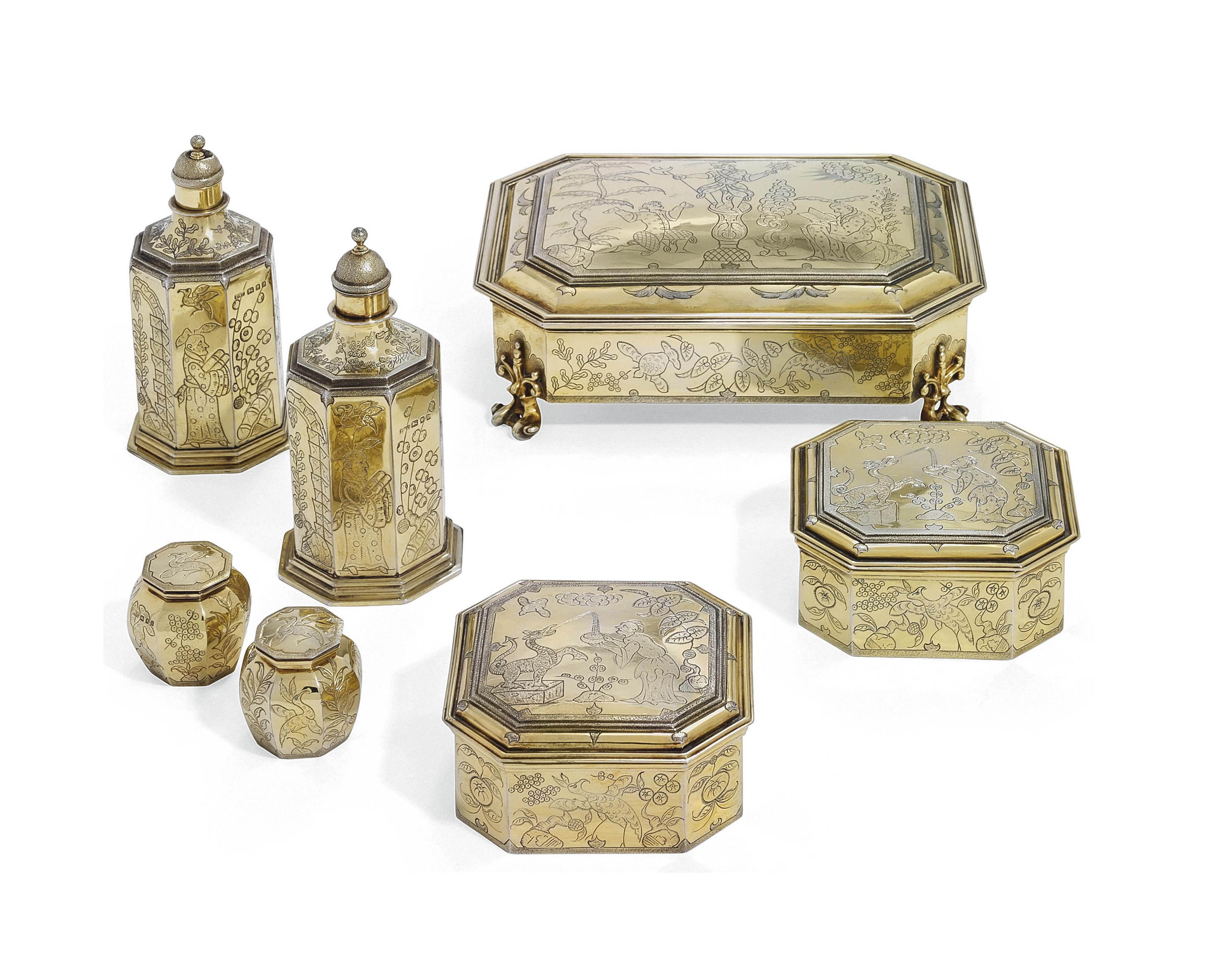 A SEVEN PIECE GEORGE V SILVER-GILT PART DRESSING-TABLE SERVICE