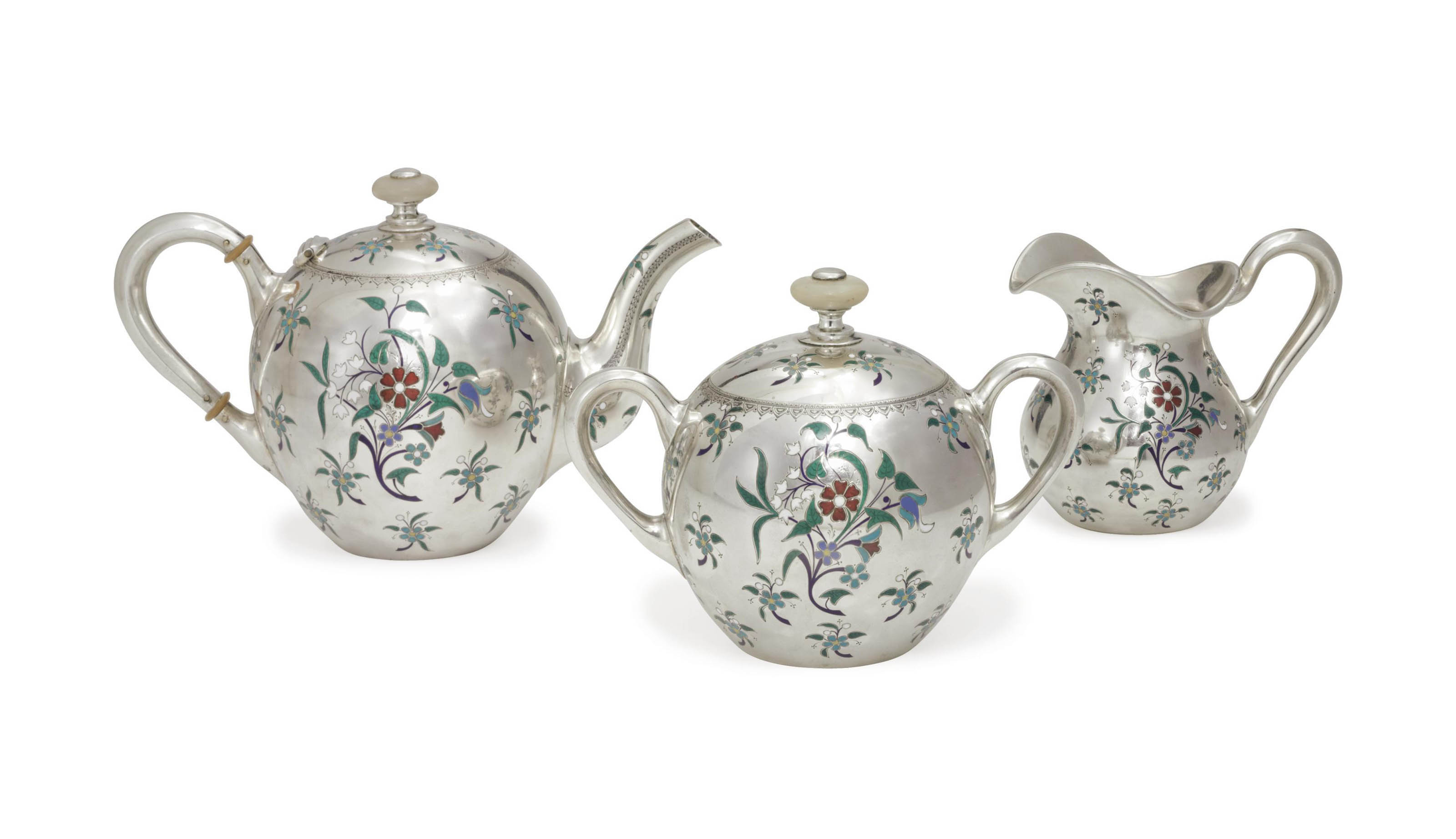 A SILVER AND CHAMPLEVÉ ENAMEL THREE-PIECE TEA SET