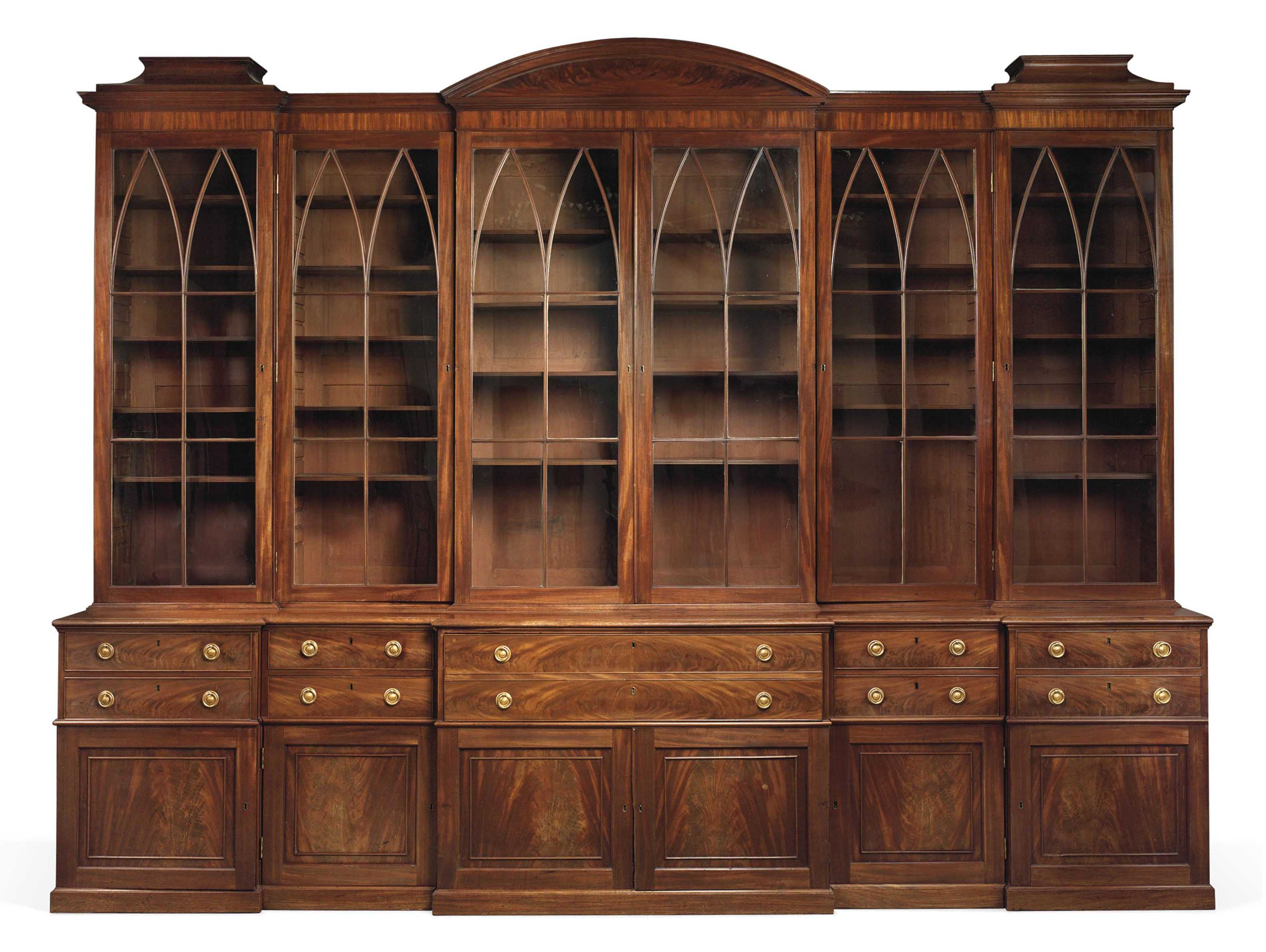 A GEORGE III MAHOGANY SECRETAIRE LIBRARY BREAKFRONT BOOKCASE