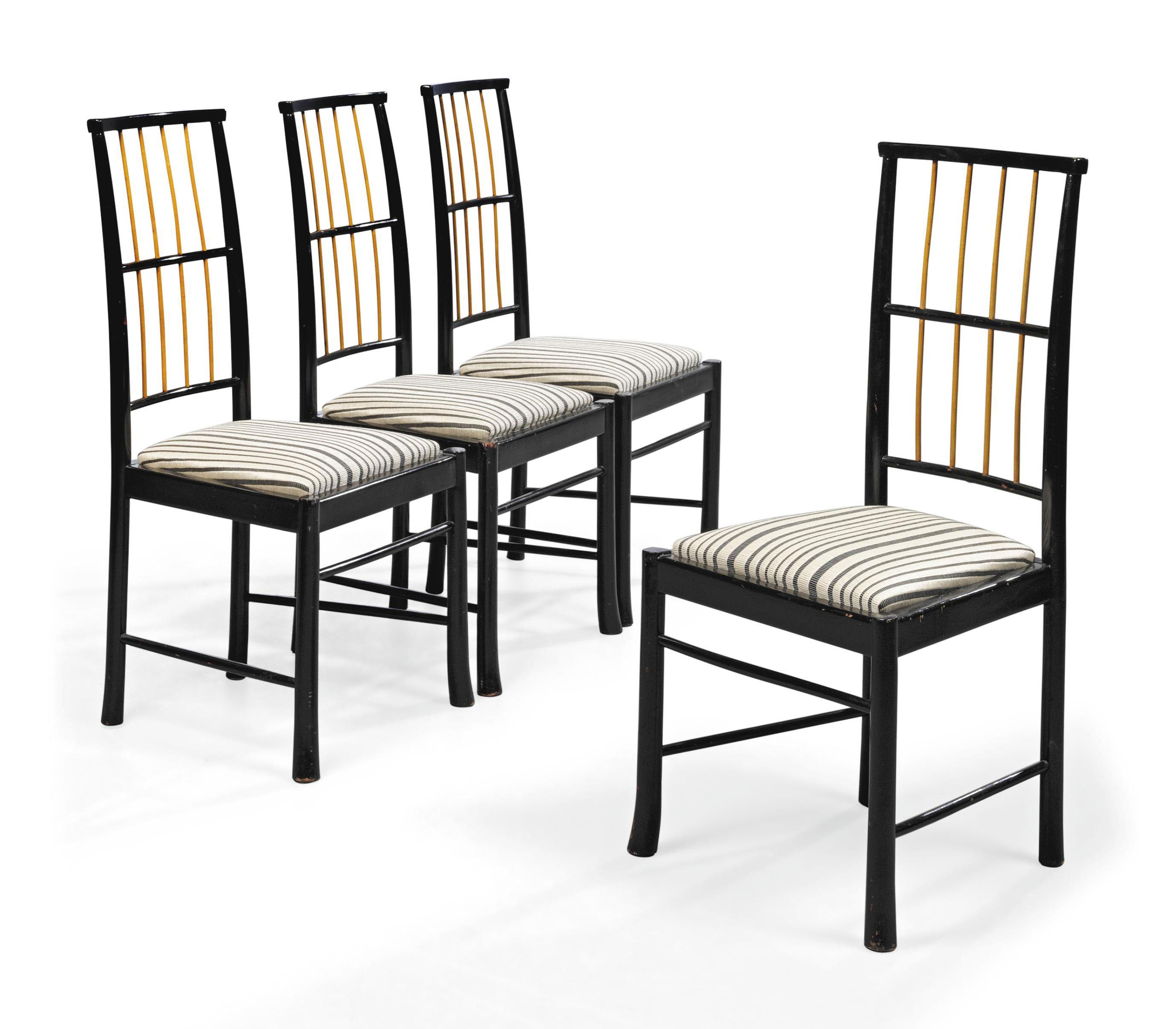A SET OF FOUR SWEDISH FRUITWOOD AND EBONISED SIDE-CHAIRS