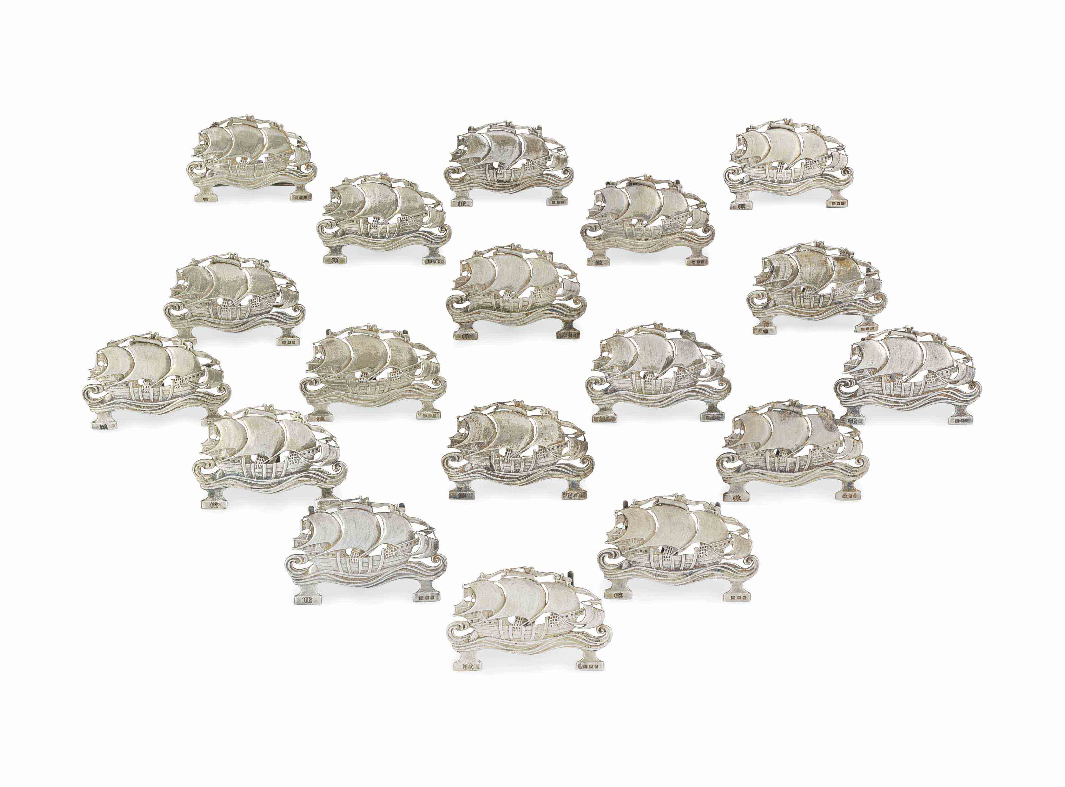 A SET OF EIGHTEEN GEORGE V SILVER PLACE-CARD HOLDERS