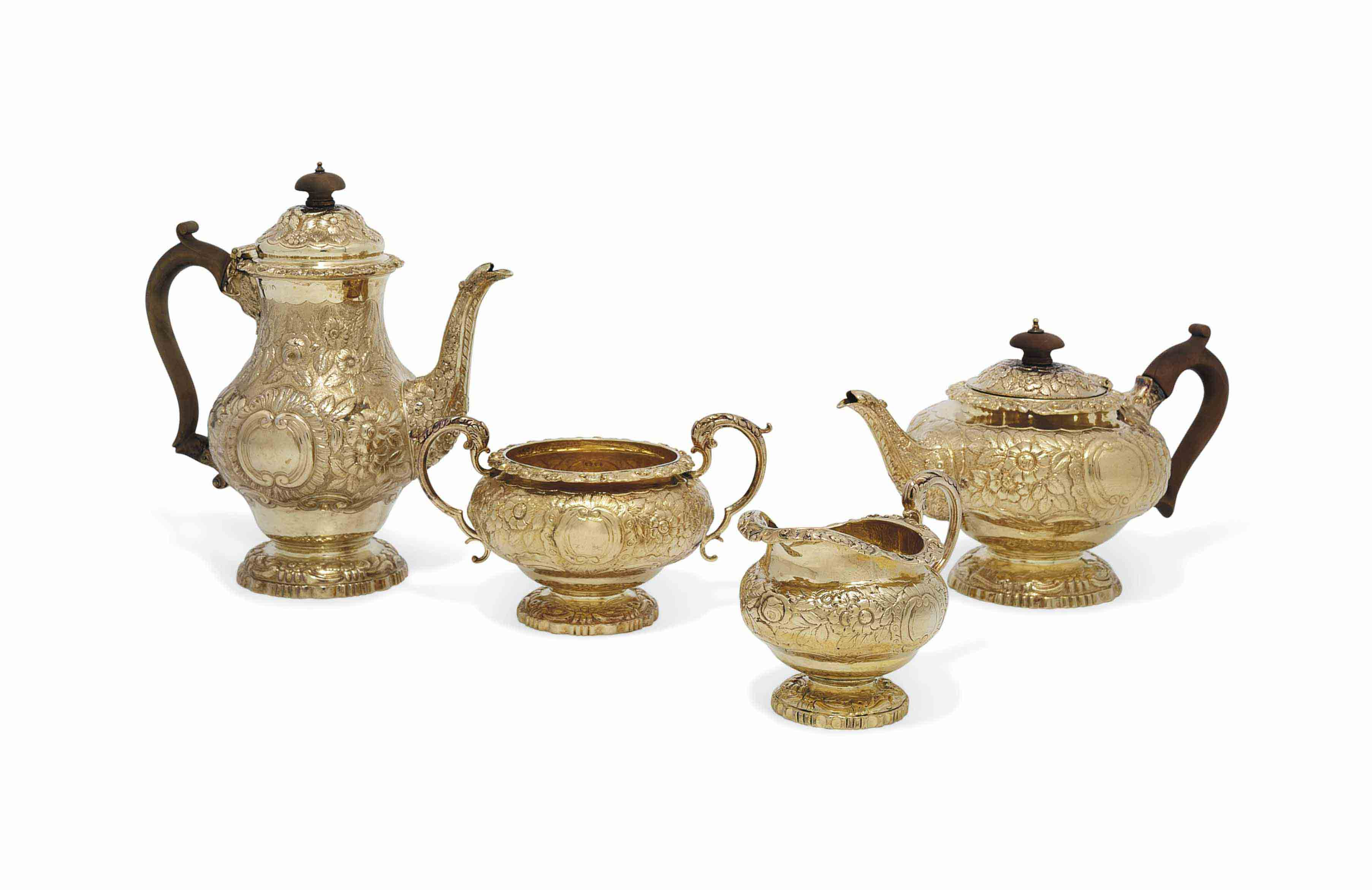A FOUR-PIECE GEORGE III SILVER-GILT TEA AND COFFEE-SERVICE