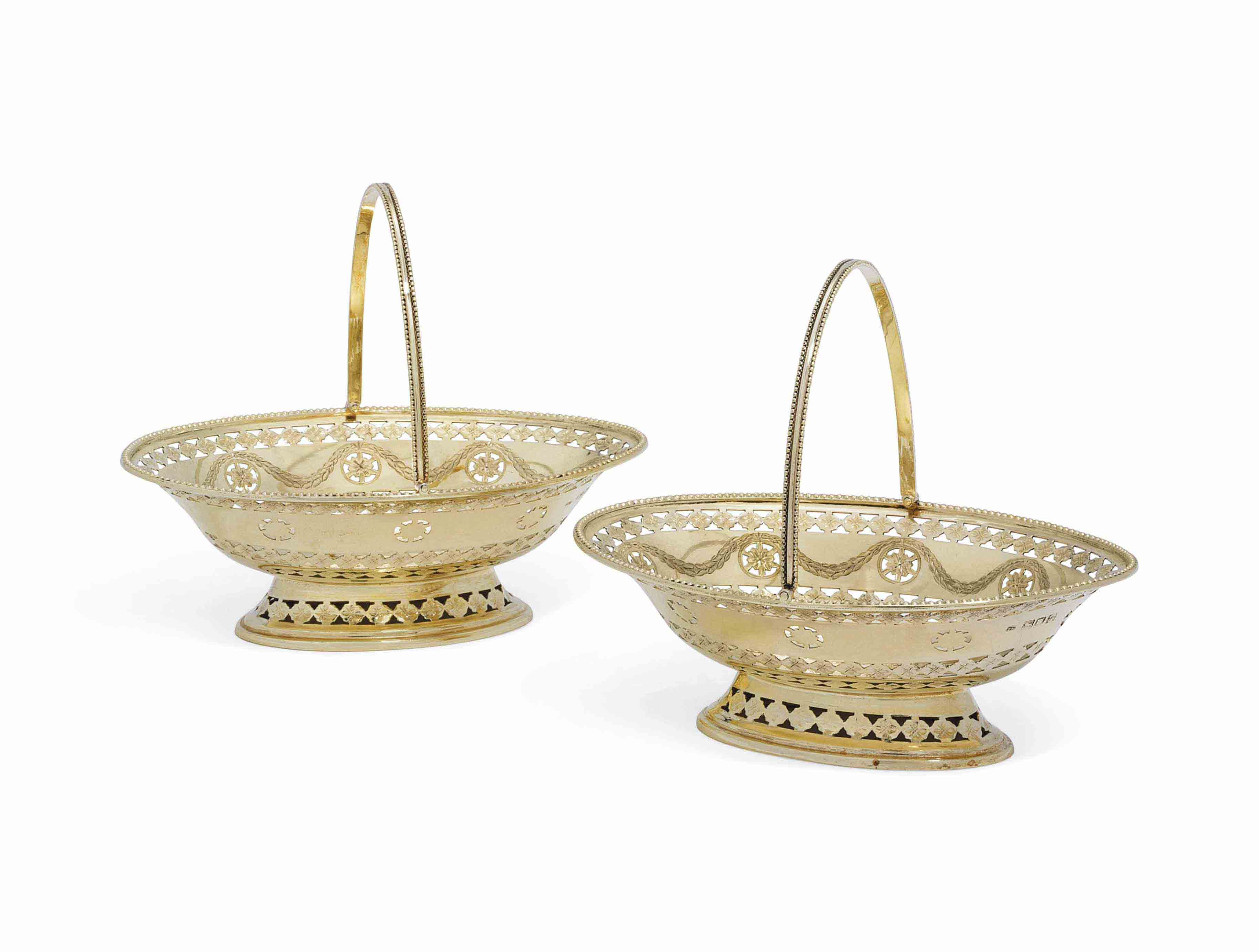 A PAIR OF EDWARD VII SILVER-GILT SWEETMEAT BASKETS