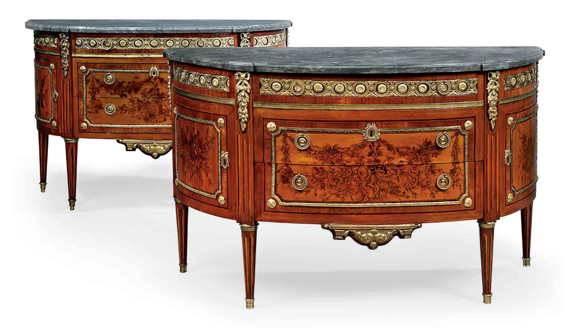A MATCHED PAIR OF LOUIS XVI ORMOLU-MOUNTED TULIPWOOD AND MARQUETRY COMMODES