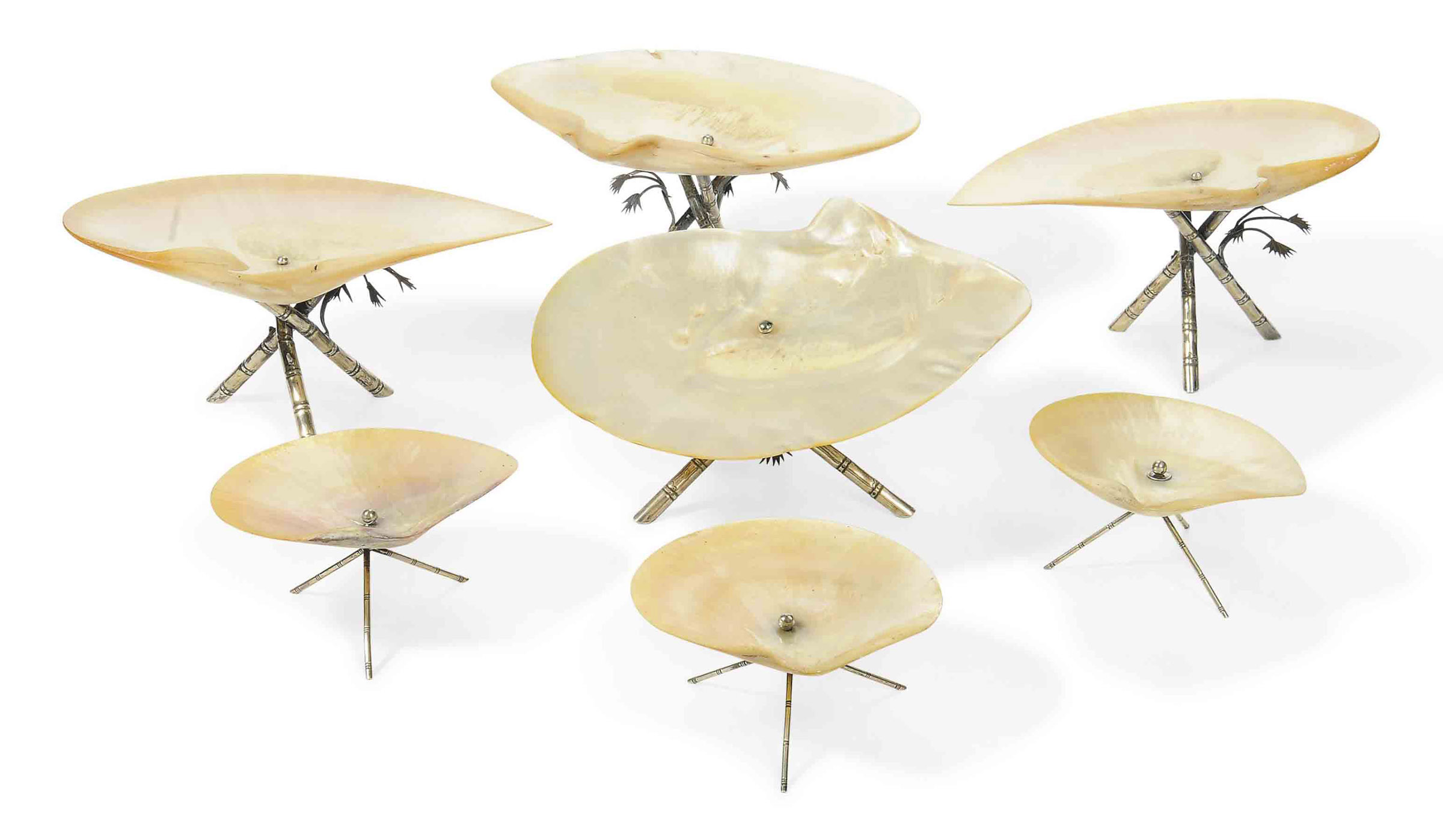 A GROUP OF SEVEN CHINESE EXPORT SILVER-MOUNTED MOTHER OF PEARL DISHES