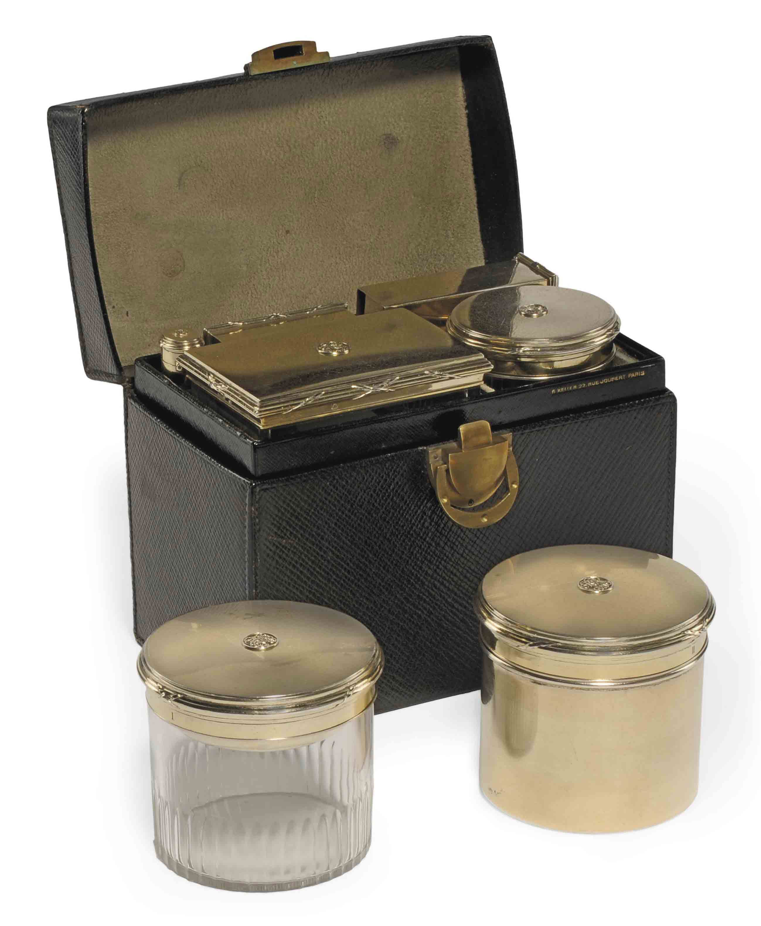 A FRENCH SILVER-GILT TRAVELLING DRESSING-TABLE SET