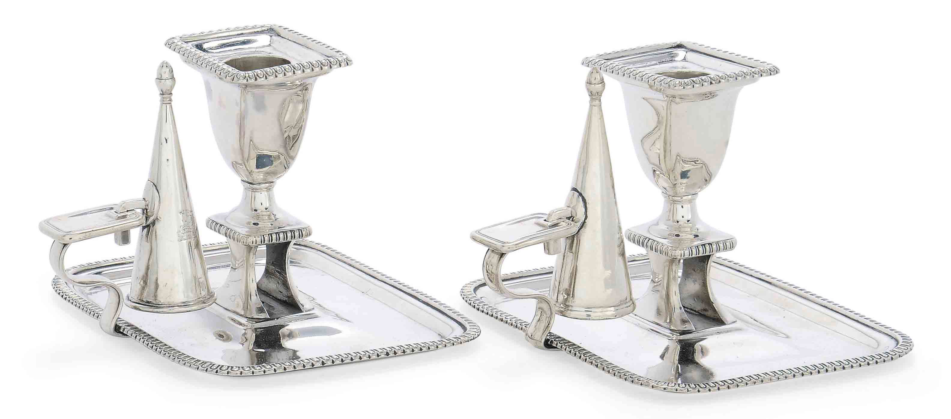 A PAIR OF GEORGE III SILVER CHAMBERSTICKS