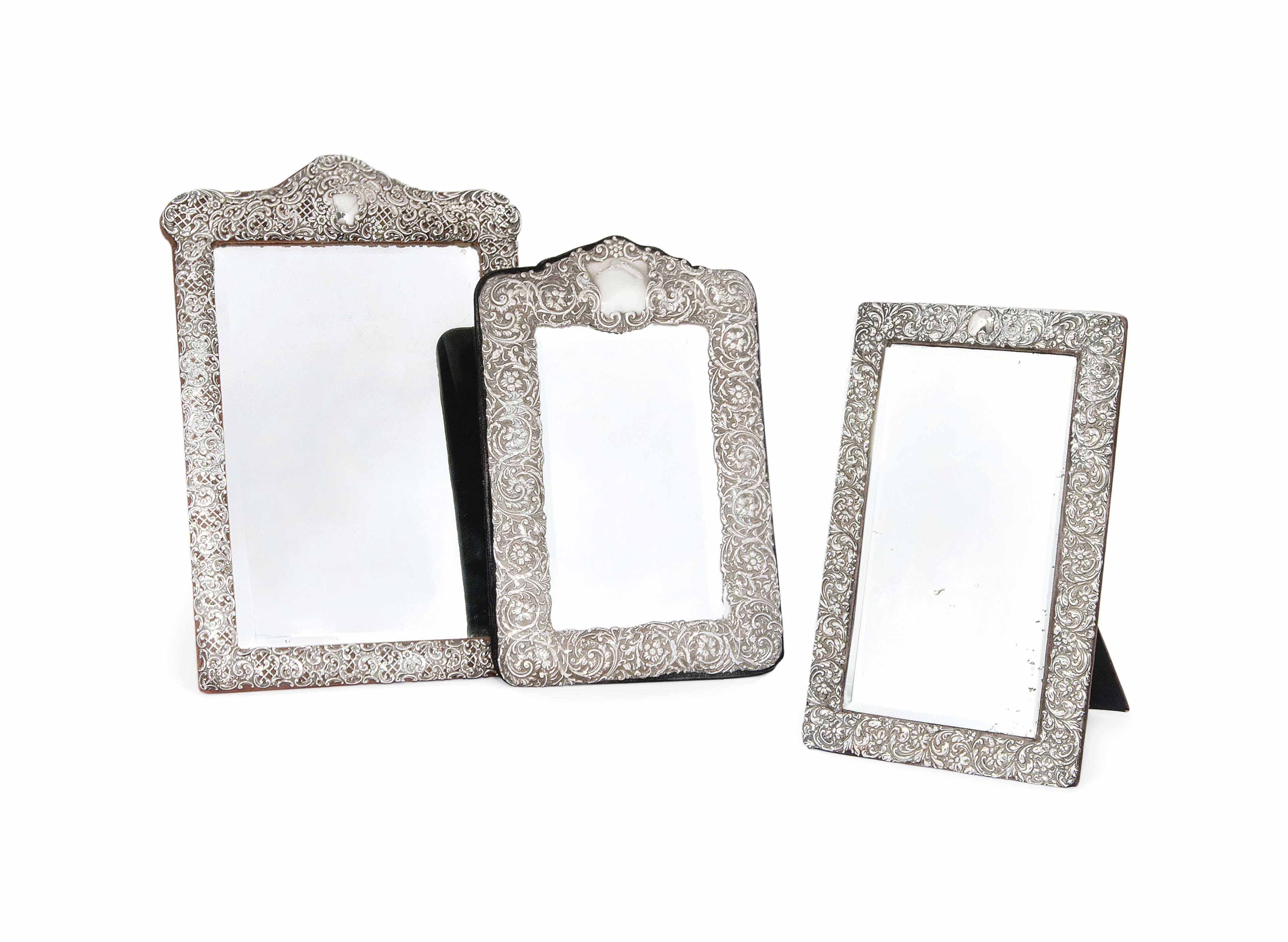 A GROUP OF THREE SILVER DRESSING TABLE MIRRORS