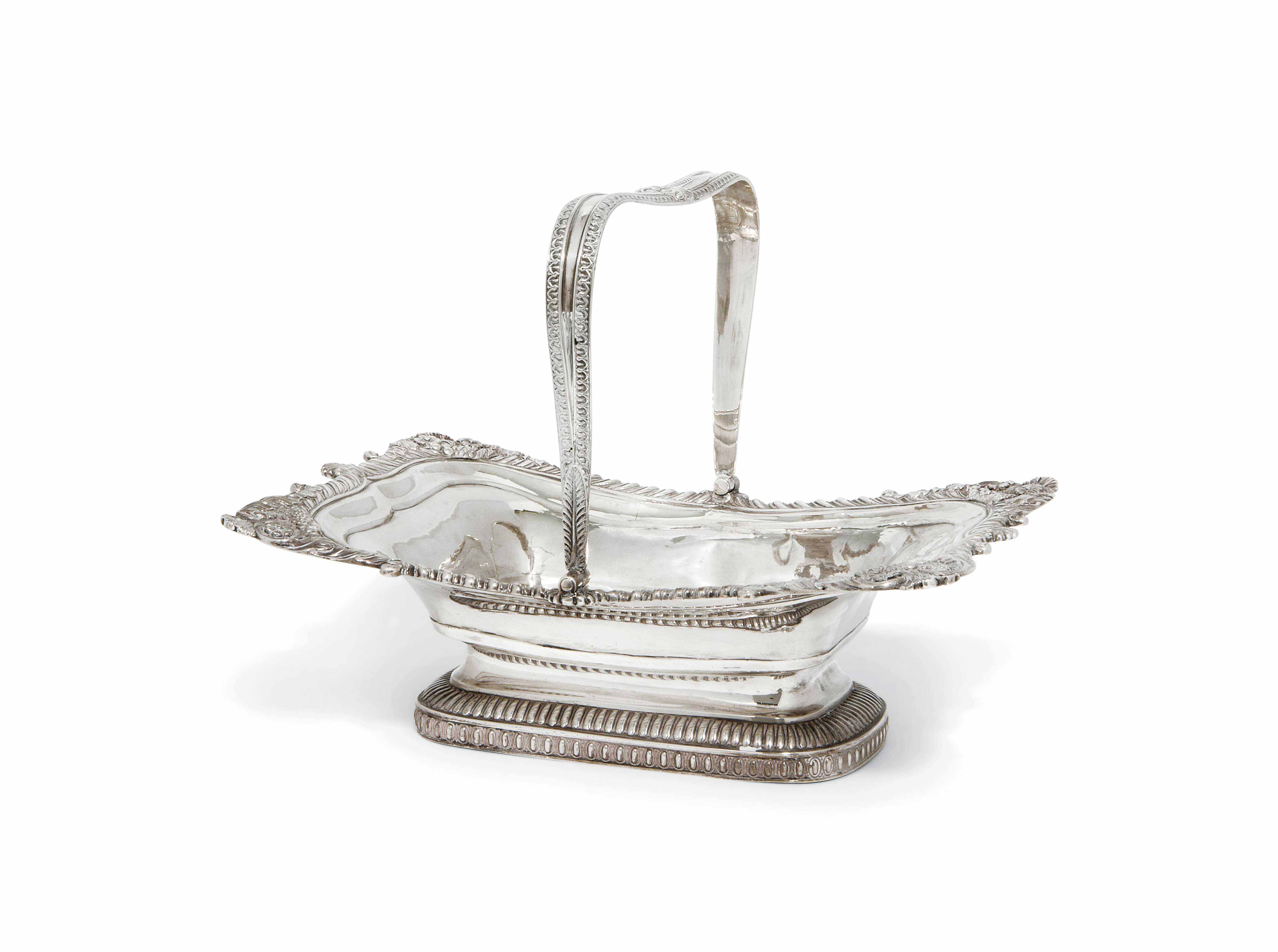 A GEORGE III SILVER SWING-HANDLED CAKE BASKET