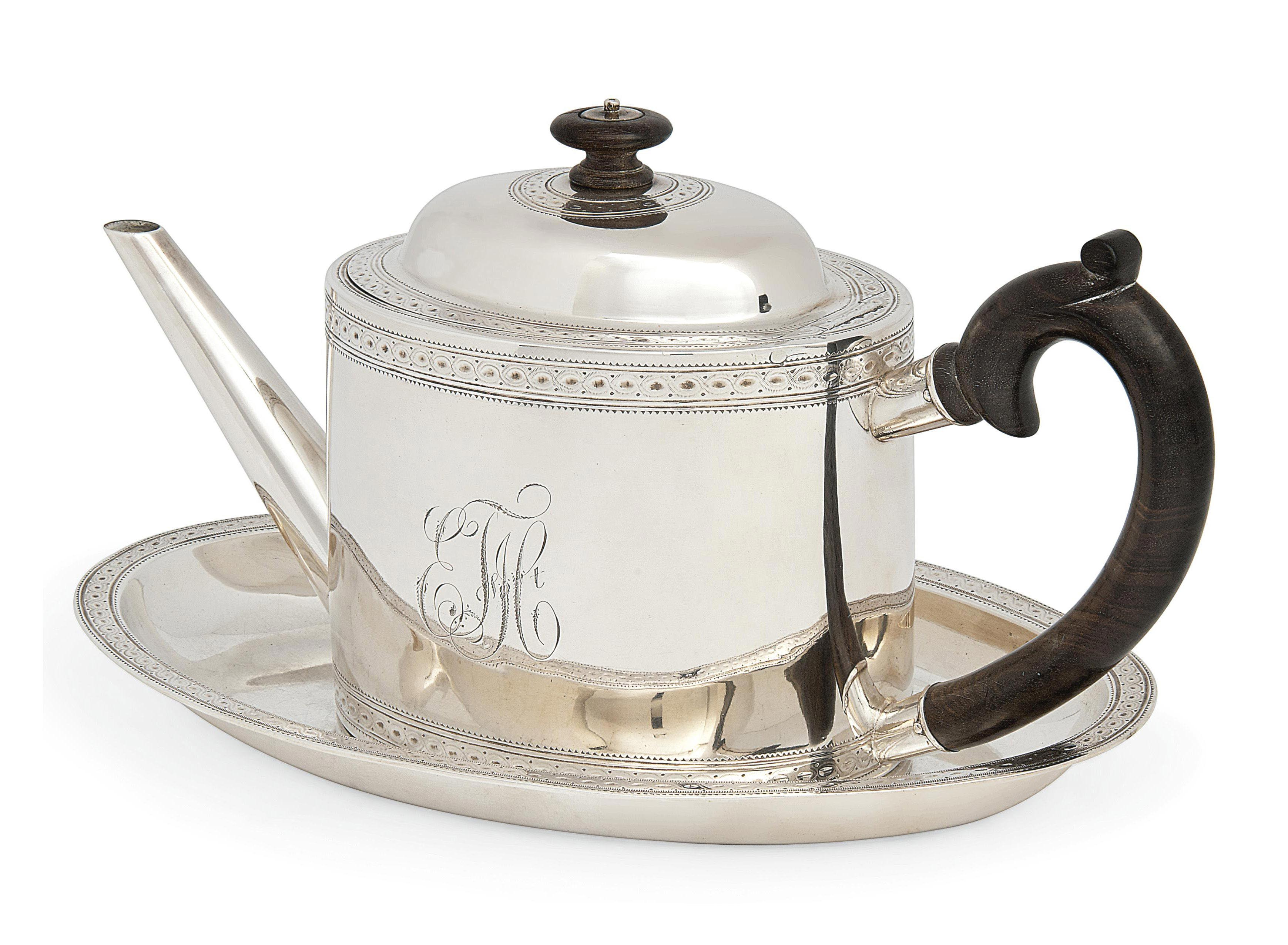 A SWISS SILVER TEAPOT AND STAND