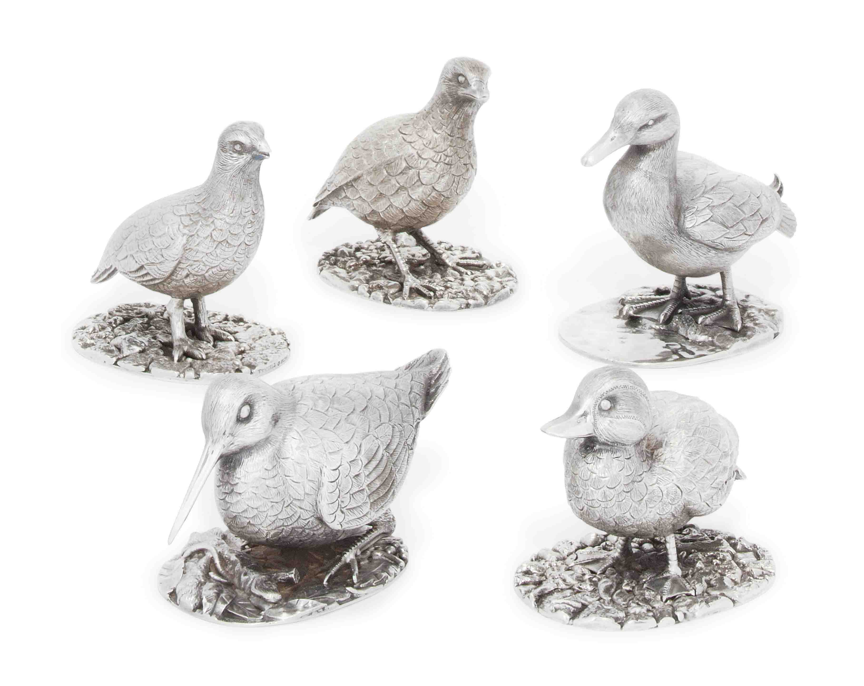 A GROUP OF FIVE SILVER GAME BIRD TABLE ORNAMENTS