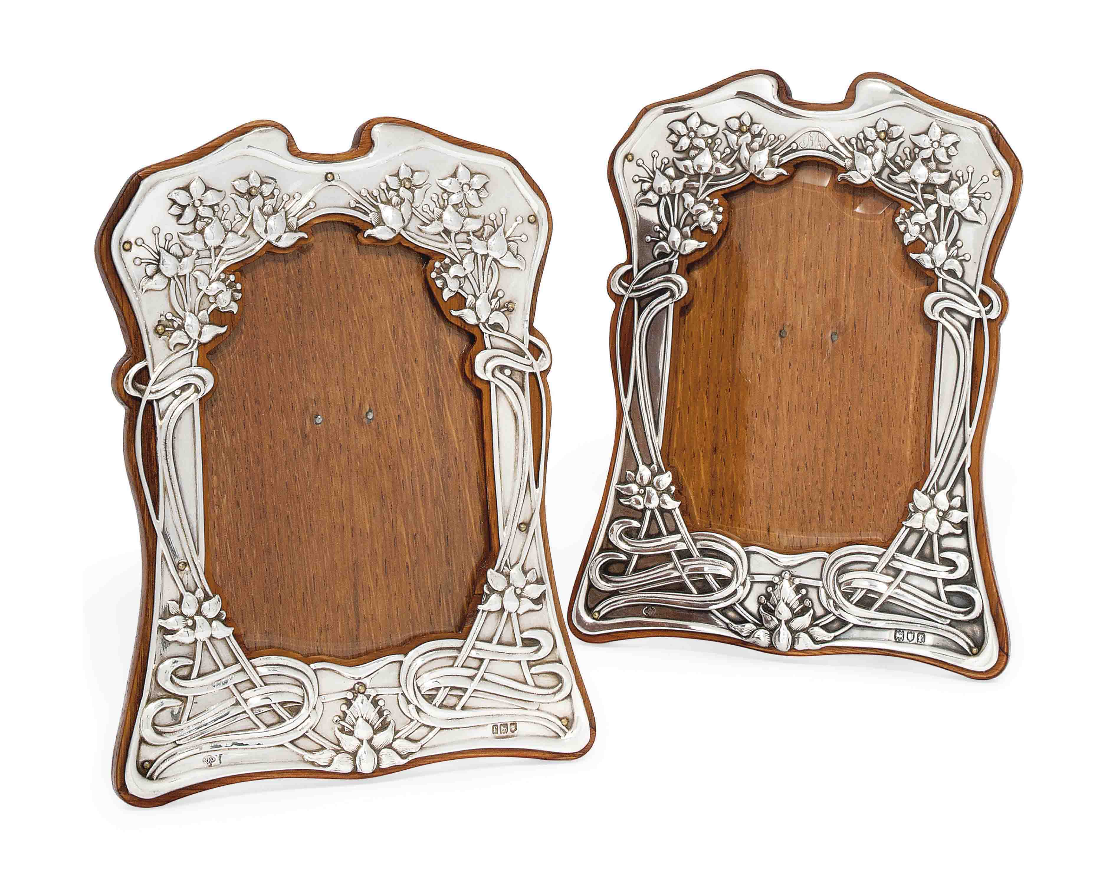 A PAIR OF EDWARDIAN SILVER ART NOUVEAU PHOTOGRAPH FRAMES