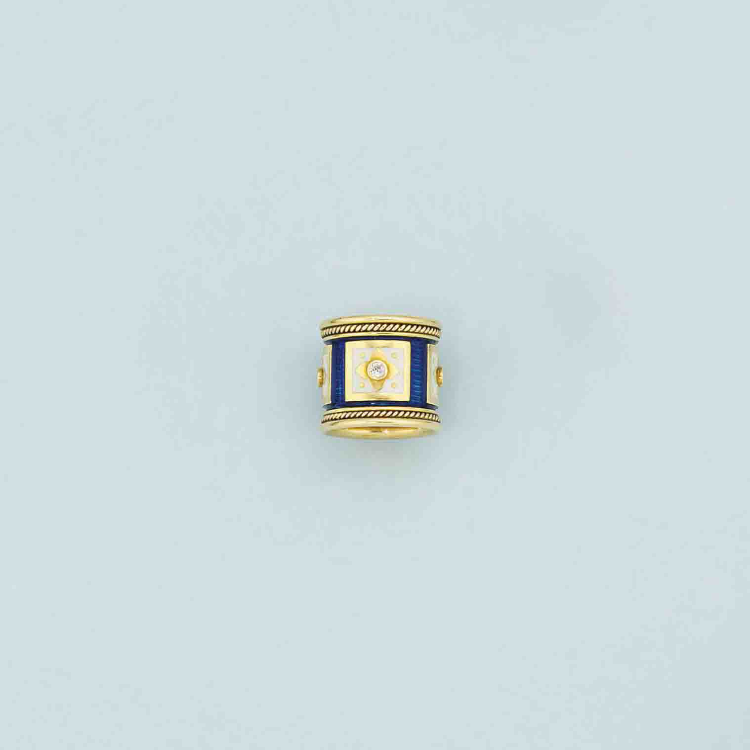 An 18ct. gold, diamond and enamel ring, by Elizabeth Gage