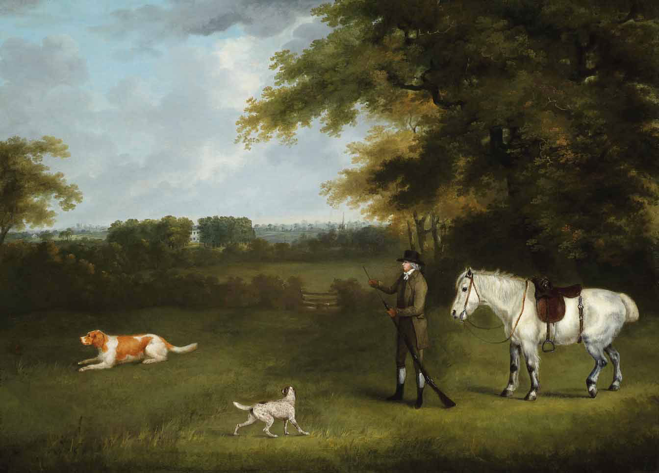 A sportsman with his dogs and pony in a wooded landscape