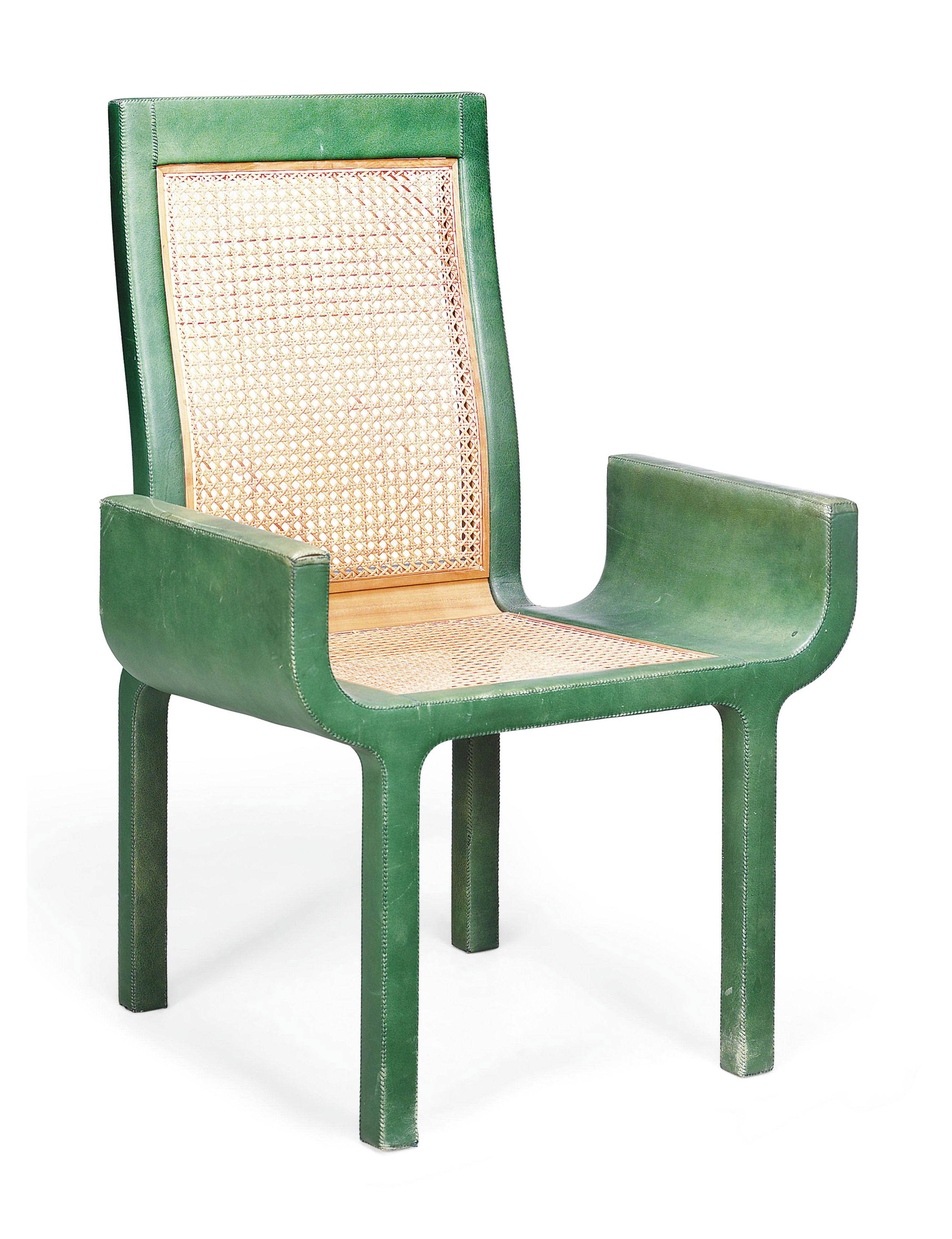 A GREEN LEATHER-COVERED ARMCHAIR