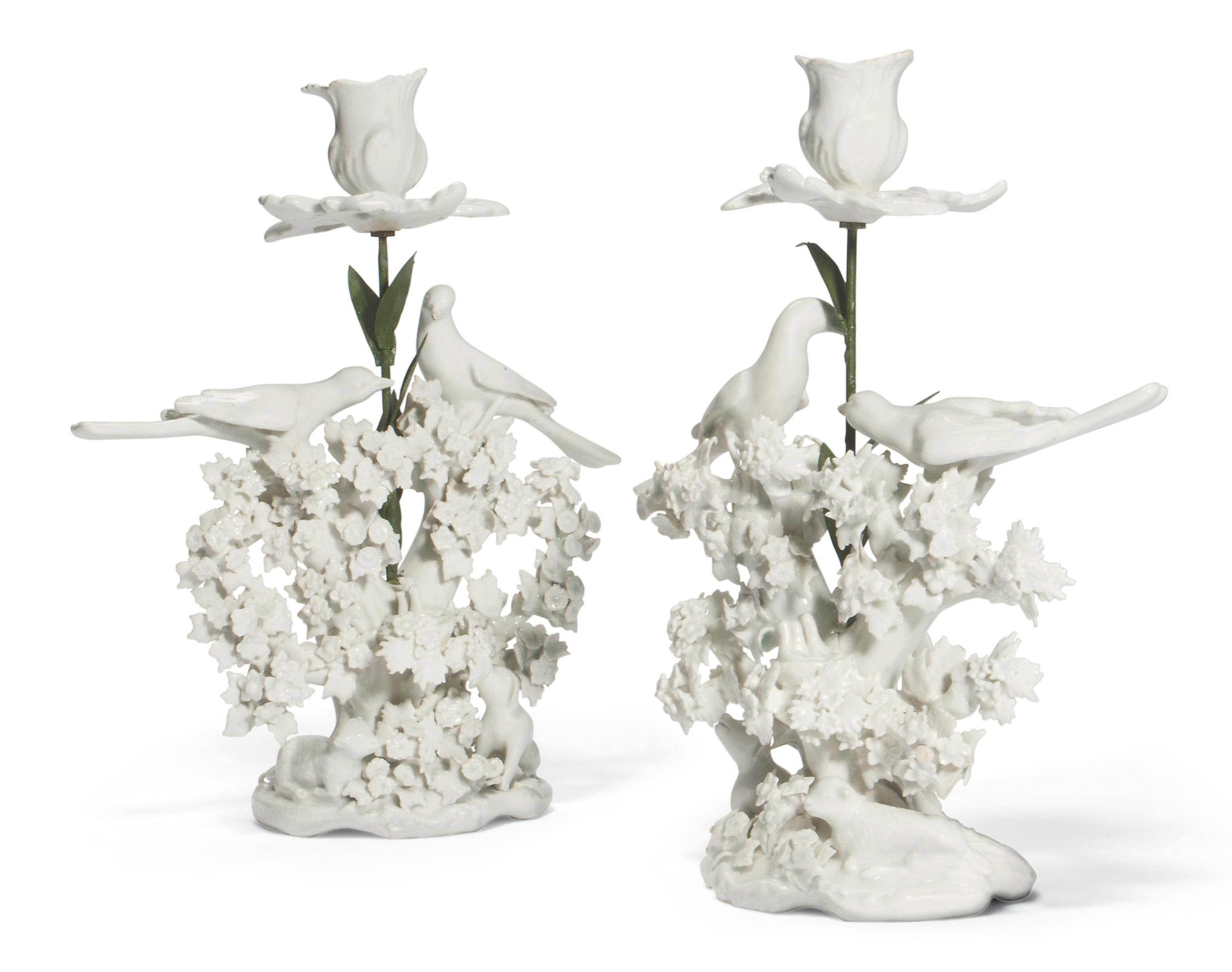 A  PAIR OF BOW WHITE 'BIRDS IN BRANCHES' CANDLESTICK GROUPS