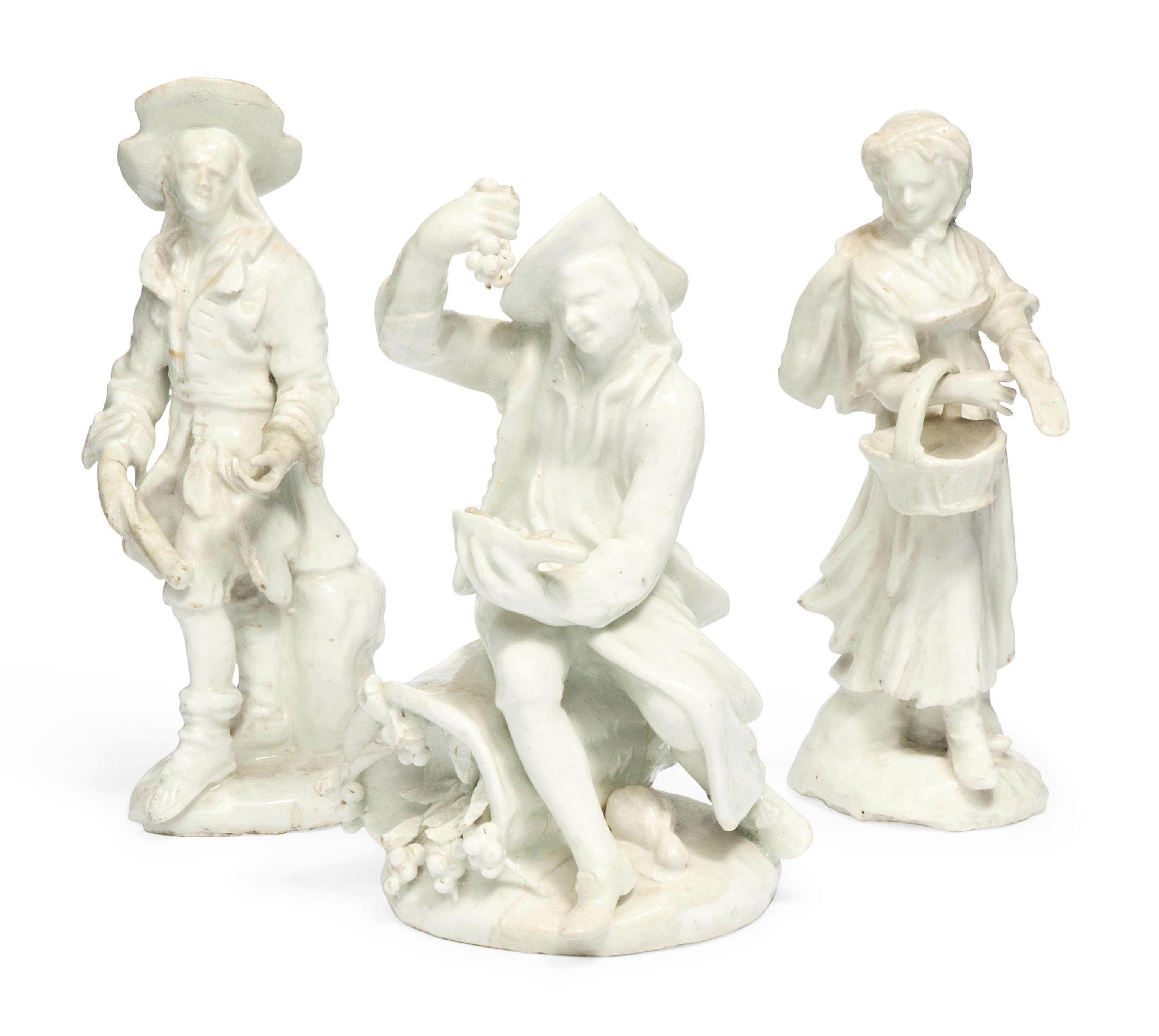 A PAIR OF BOW WHITE FIGURES OF BEGGARS AND A FIGURE EMBLEMATIC OF AUTUMN FROM THE SEATED RUSTIC SEASONS