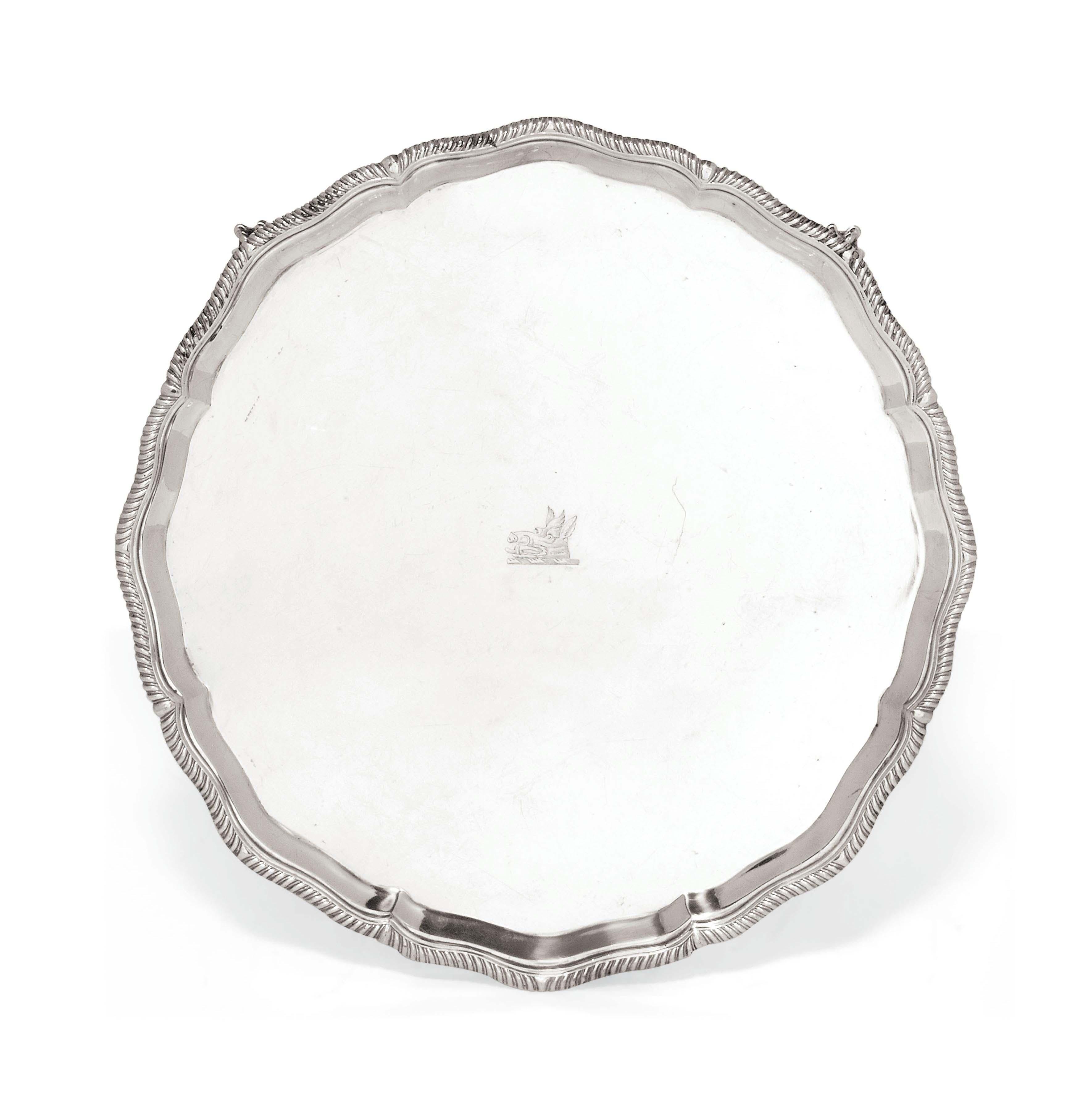 A SHAPED CIRCULAR SILVER SALVER