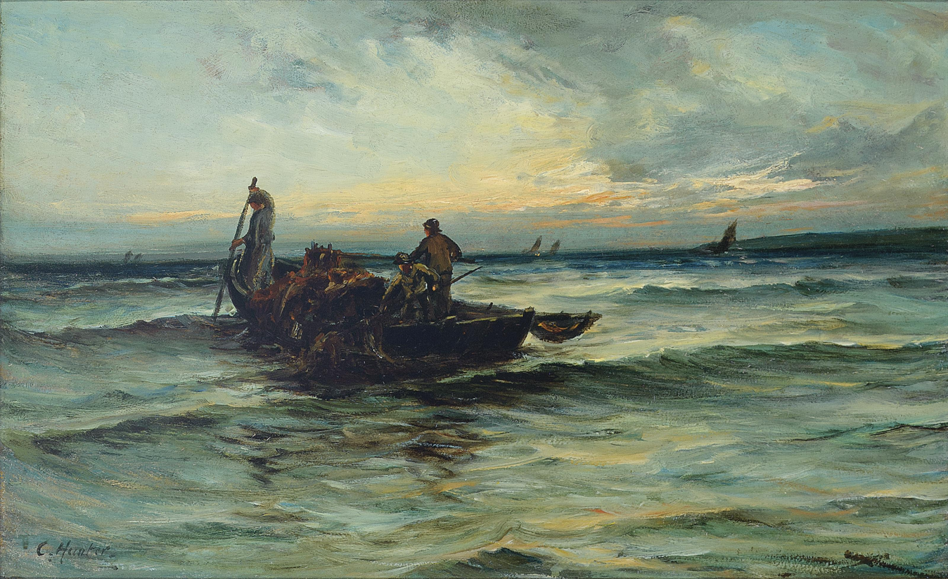 Hauling in the nets at sunset