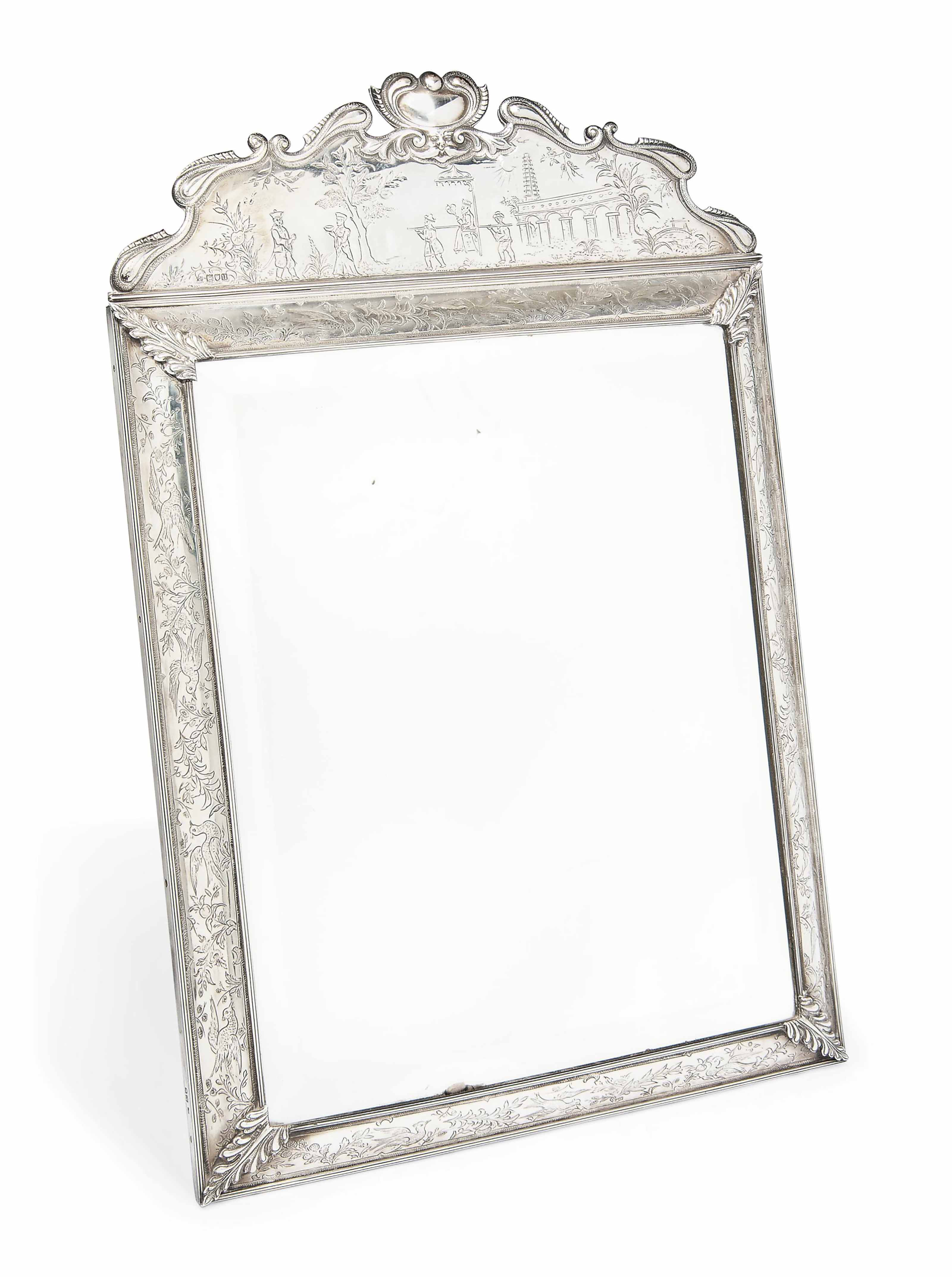 A SILVER REPRODUCTION OF A WILLIAM AND MARY CHINOISERIE DRESSING TABLE MIRROR