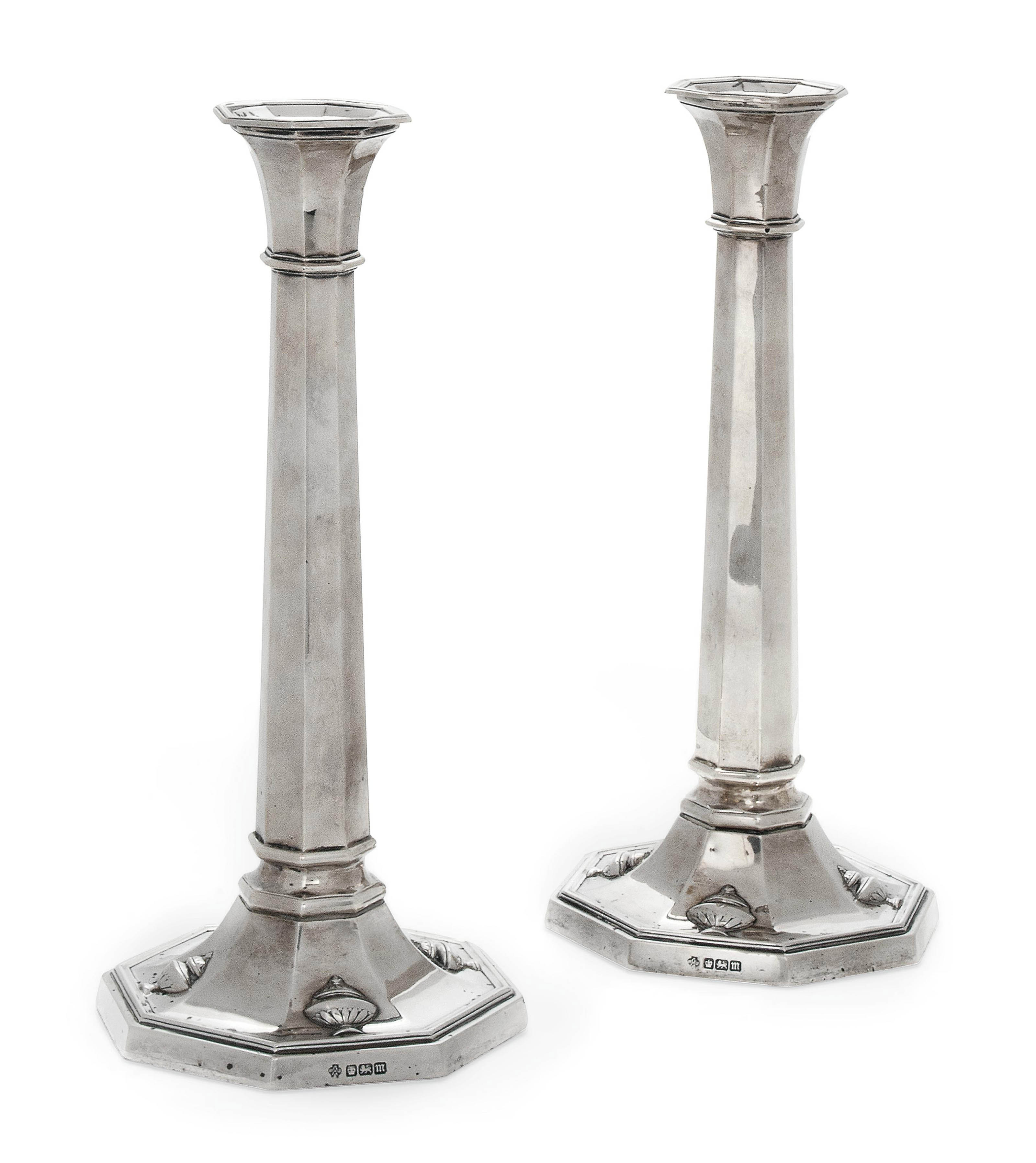 A PAIR OF EDWARDIAN OCTAGONAL SILVER CANDLESTICKS