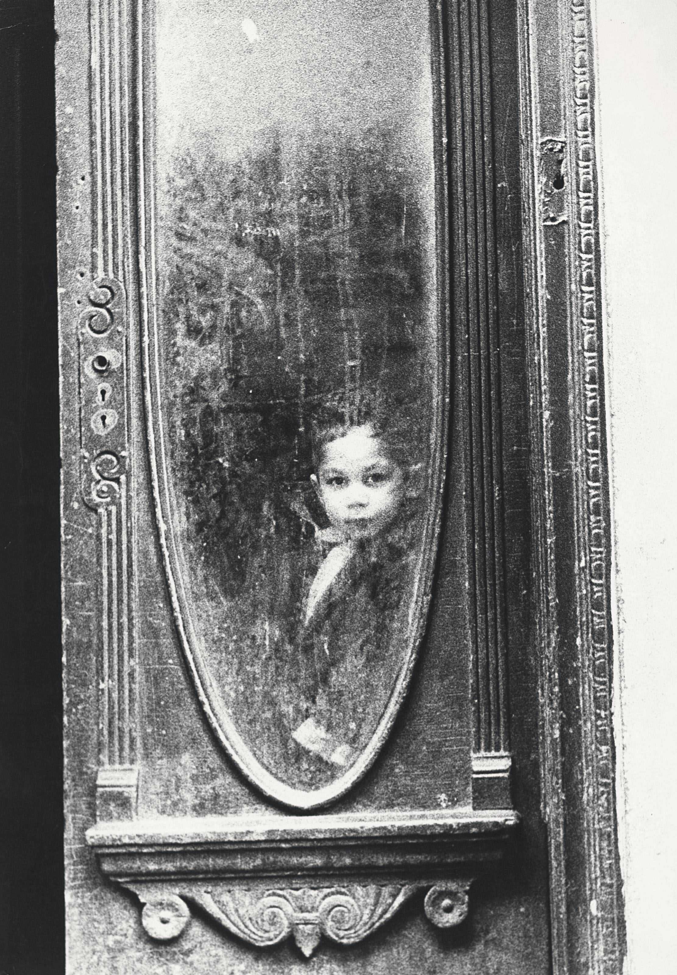 Young boy at the window, New York, 1950s