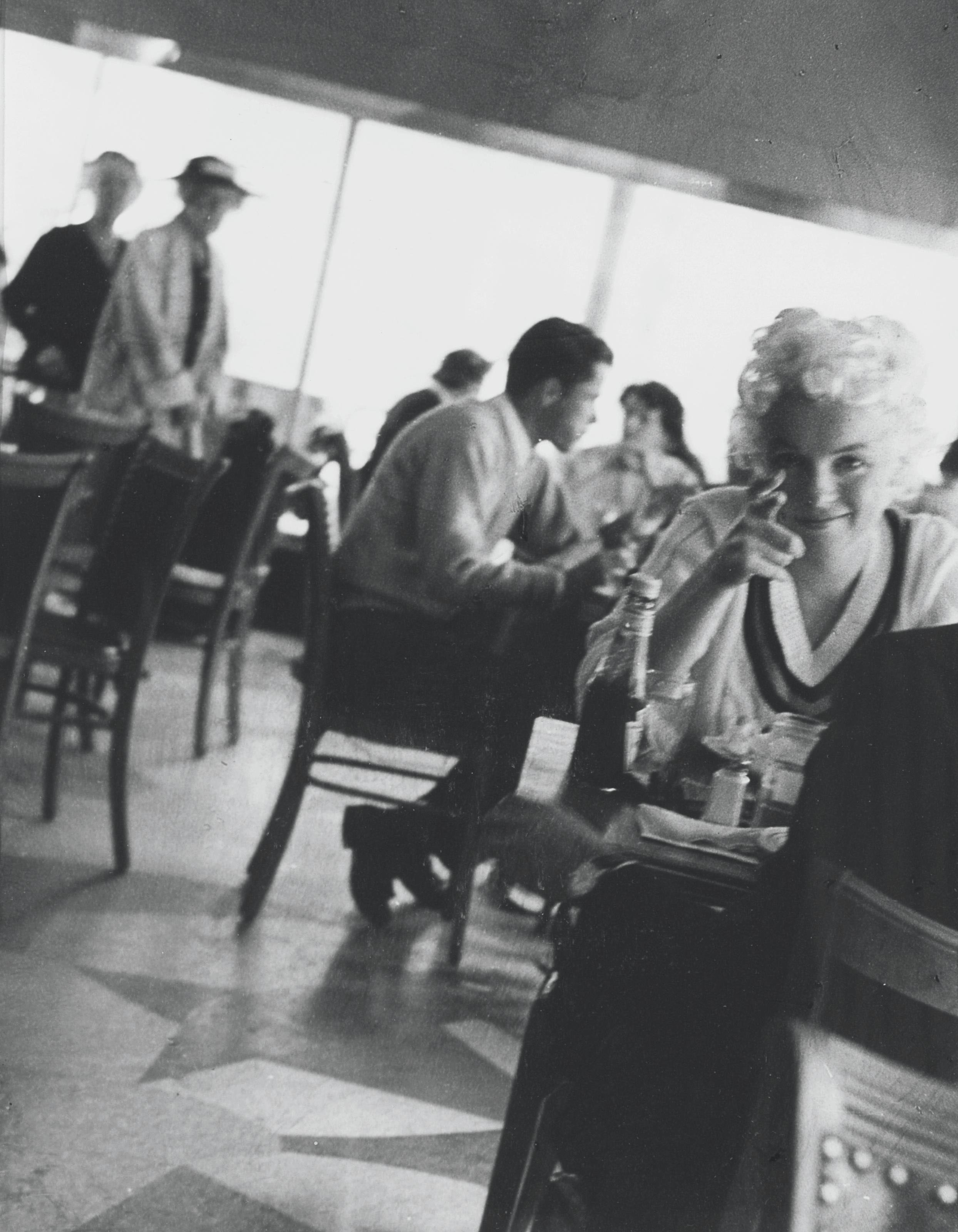 Marilyn Monroe catches Roy stealing a shot, 1955