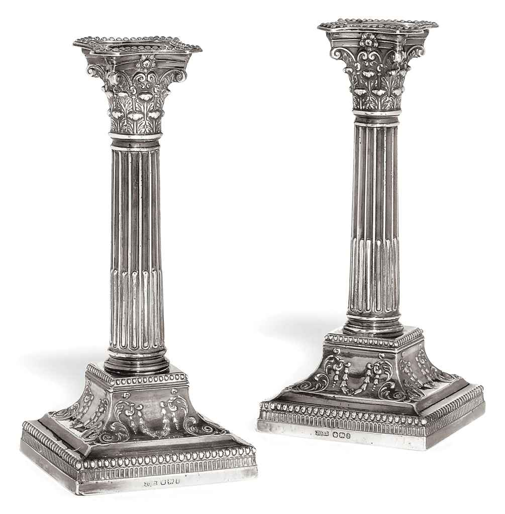 A PAIR OF LATE VICTORIAN CORINTHIAN COLUMN CANDLESTICKS