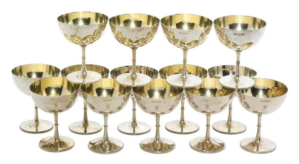 FOURTEEN VICTORIAN SILVER CHAMPAGNE GOBLETS