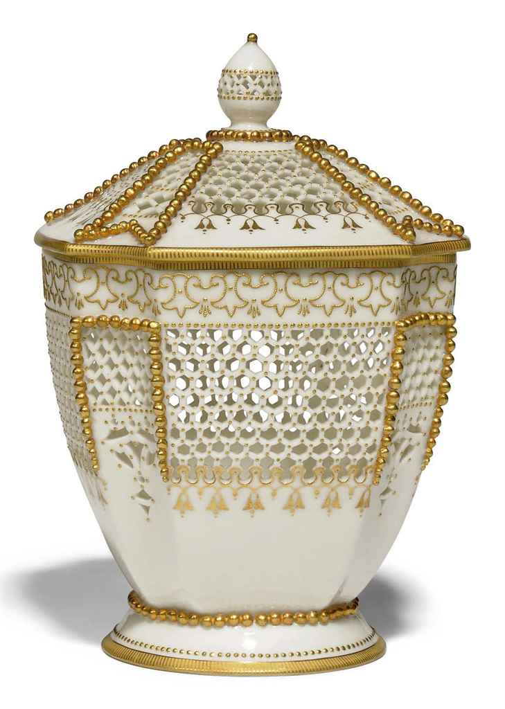 A ROYAL WORCESTER RETICULATED JAR AND COVER BY GEORGE OWEN