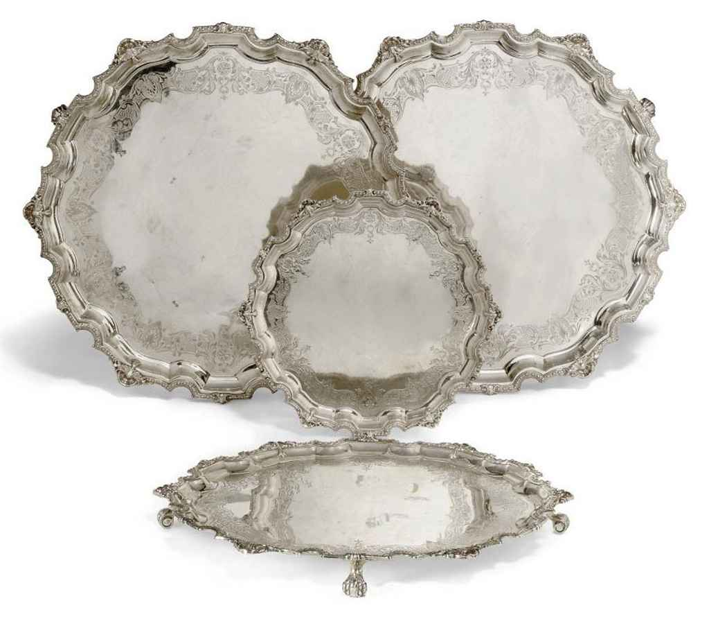 A GROUP OF FOUR GRADUATED SILVER SALVERS