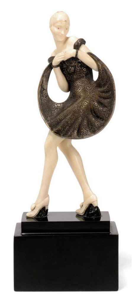 A PIERRE LE FAGUAYS PATINATED BRONZE AND IVORY FIGURE OF A DANCER