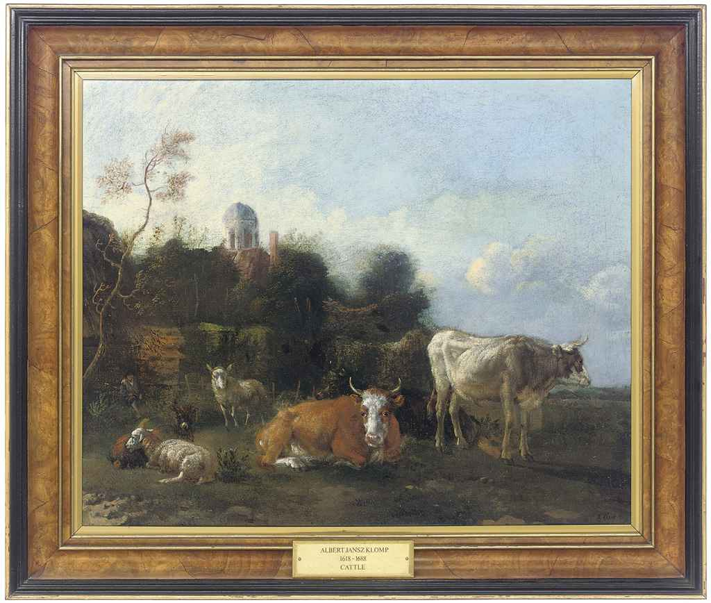 Cattle and sheep resting in a pastoral landscape