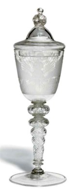 AN ENGRAVED GLASS GOBLET AND A