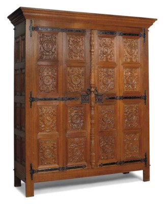 A LARGE FLEMISH OAK CUPBOARD