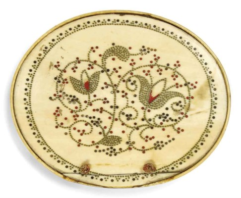 AN OVAL IVORY AND PIQUE INLAID