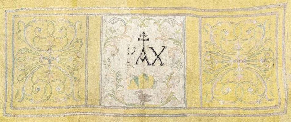 AN EMBROIDERED ALTAR FRONTAL