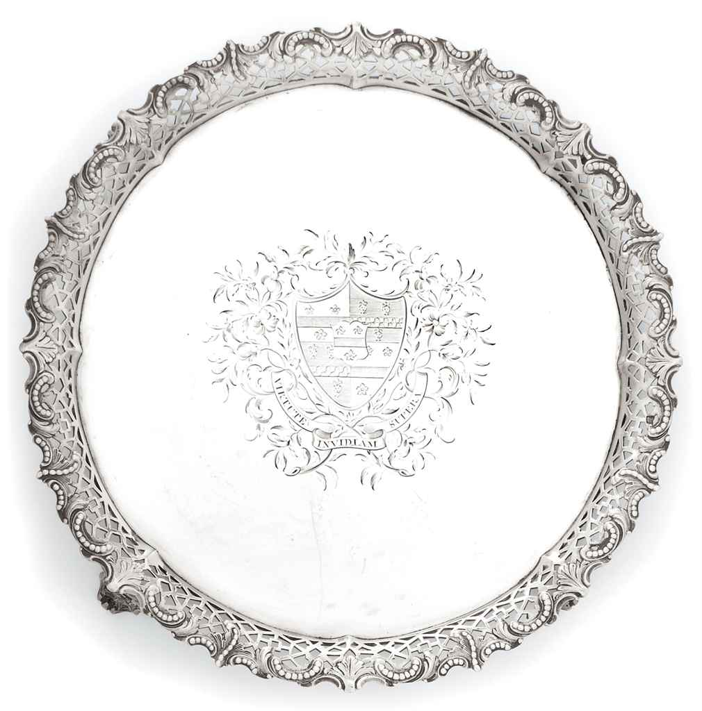 A GEORGE III SILVER SALVER WITH CAST BORDER