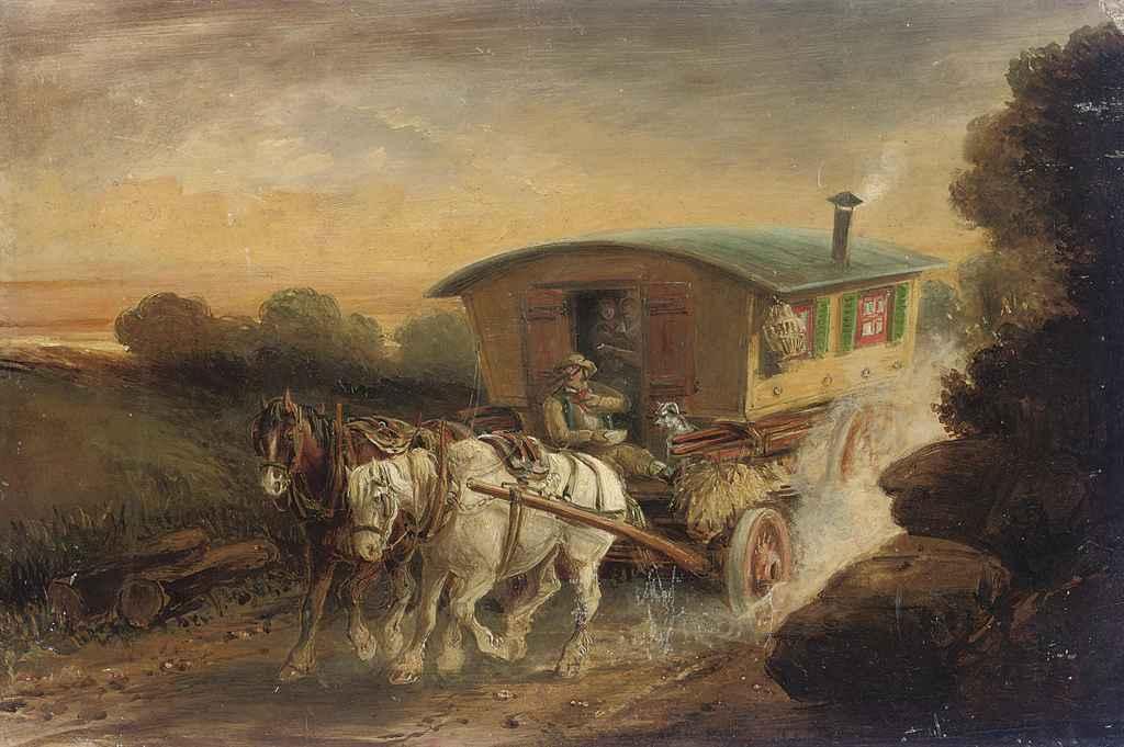 A horse-drawn gypsy caravan on a track