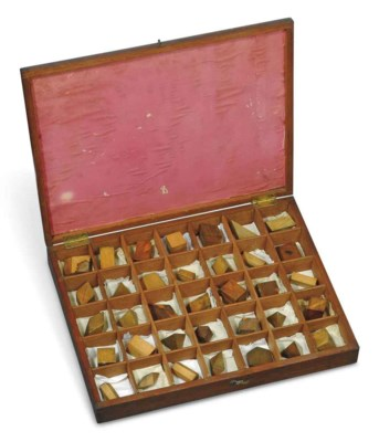 A cased set of 35 wooden cryst