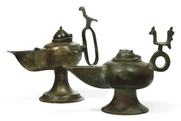 TWO KHORASSAN BRONZE OIL LAMPS