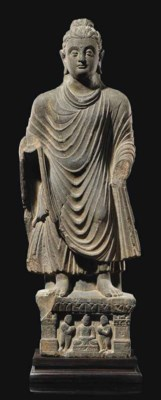 A GREY SCHIST STATUE OF BUDDHA