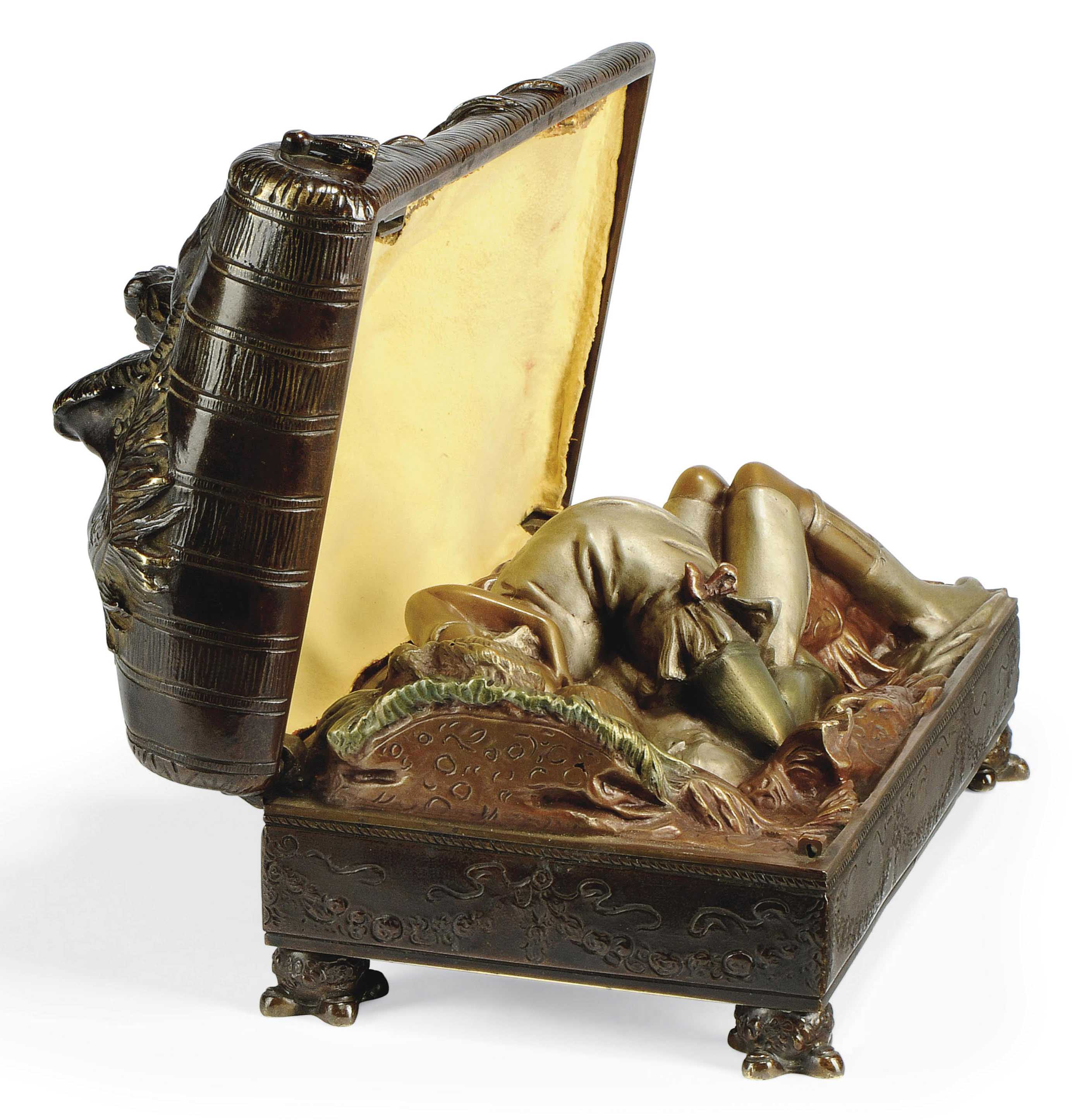 AN EROTIC, PATINATED AND COLD-PAINTED BRONZE BOX WITH HINGED COVER AND KEY ATTRIBUTED TO BRUNO ZACH