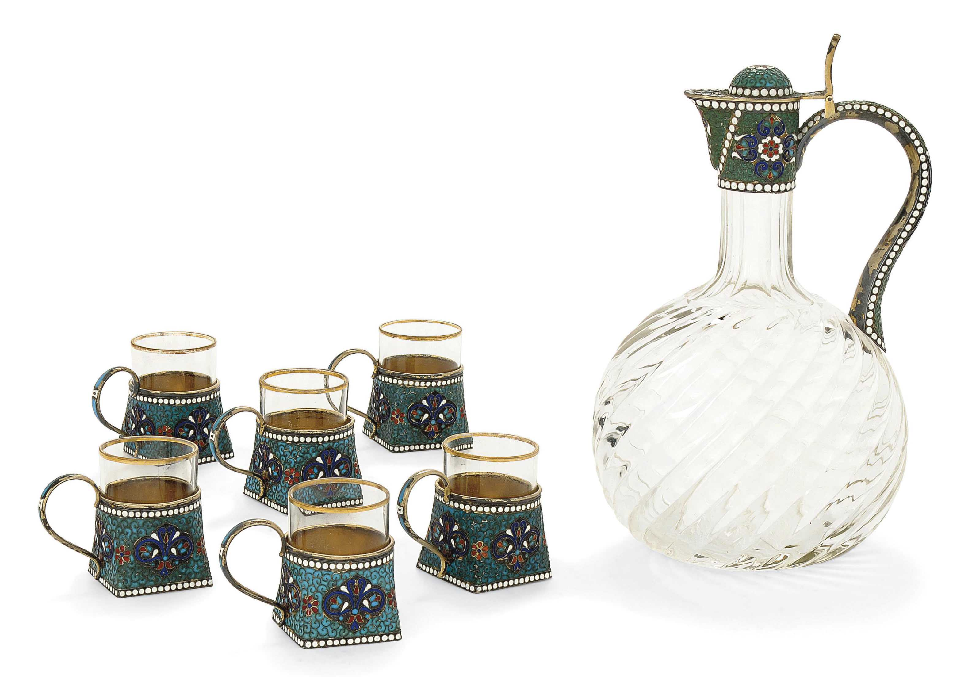 A RUSSIAN SILVER-GILT AND CLOISONNE ENAMEL VODKA JUG WITH 6 VODKA CUPS EN SUITE