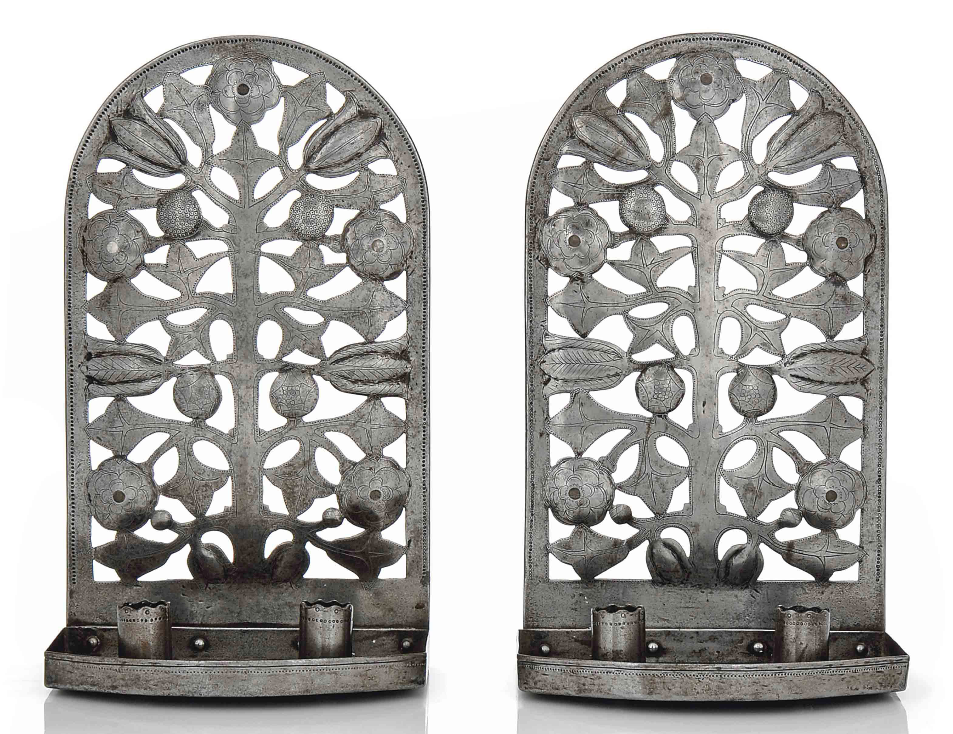 A PAIR OF ARTS & CRAFTS WALL SCONCES DESIGNED BY ERNEST GIMSON (1864-1919) AND EXECUTED BY ALFRED BUCKNELL