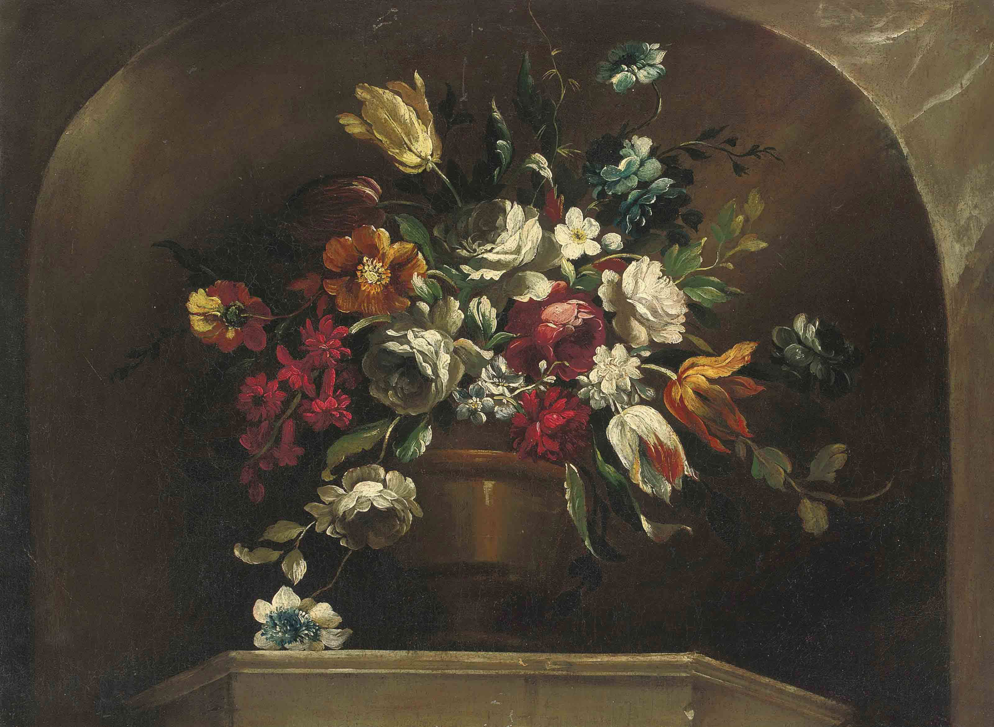 Roses, tulips and other flowers in an urn on a ledge, in a stone niche