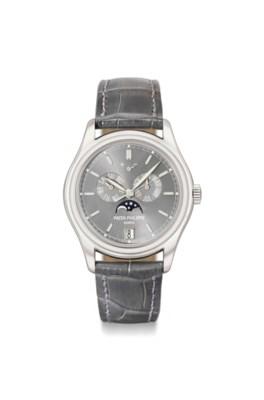 Patek Philippe A fine platinum automatic annual calendar wristwatch with sweep centre seconds